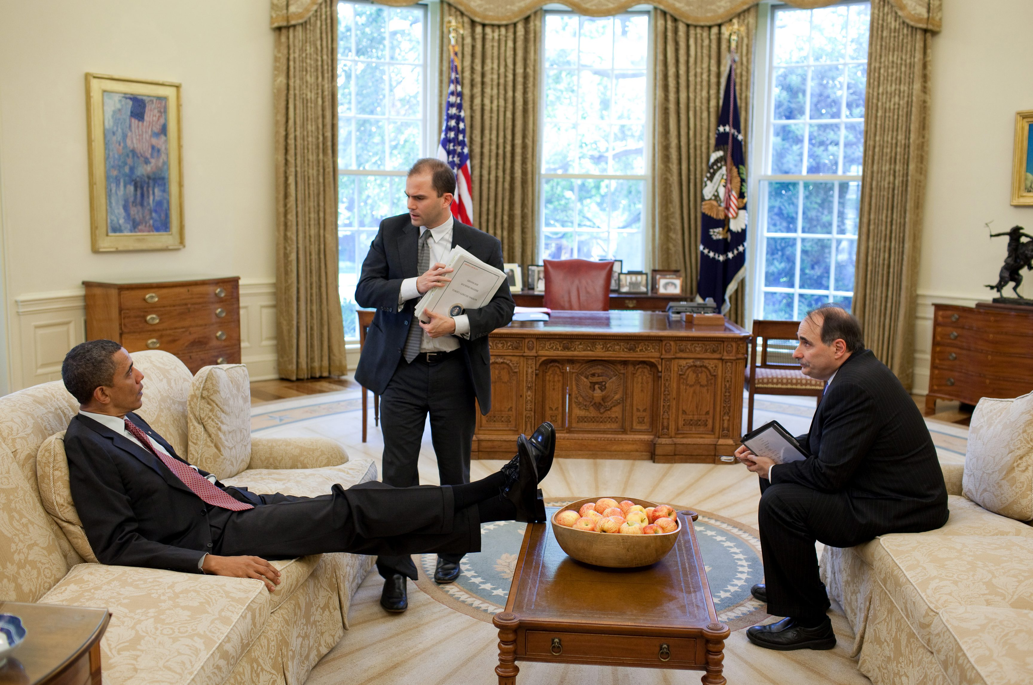 U.S. President Barack Barack Obama talks with Deputy National Security Advisor for Strategic Communication Ben Rhodes (C) and Senior Advisor David Axelrod (R) in the Oval Office, in this White House handout photograph taken on May 21, 2010 and released on June 7, 2010.