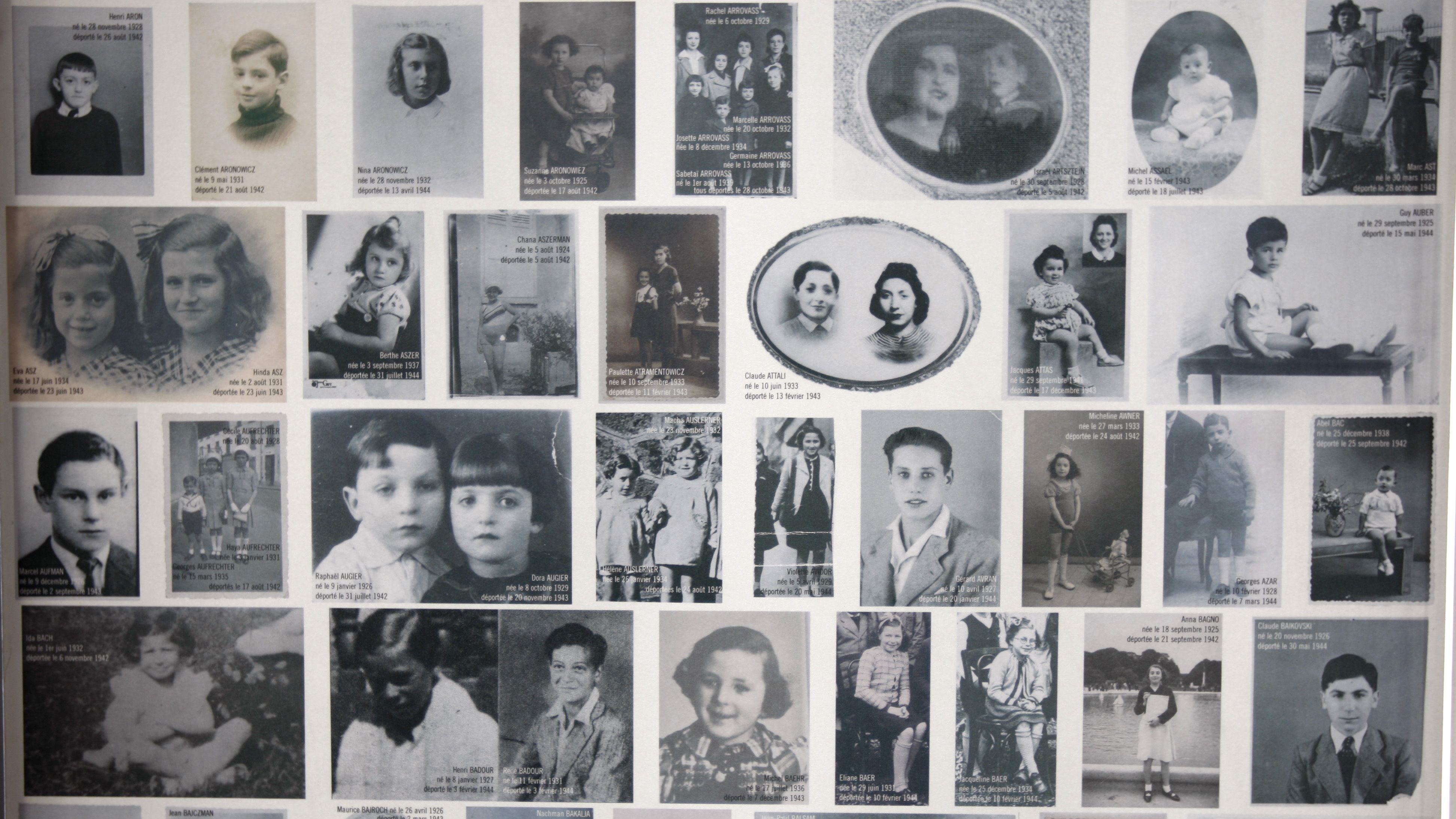 Some of  2.500 headshots of young Jews deported from France during WWII are put on display at the Shoah Memorial in Paris, February 18, 2008. France's President Nicolas Sarkozy proposed February 13  that primary school children should know the name and life story of a French-Jewish child who died in the Holocaust.    REUTERS/Charles Platiau  (FRANCE) - RTR1X8ZT