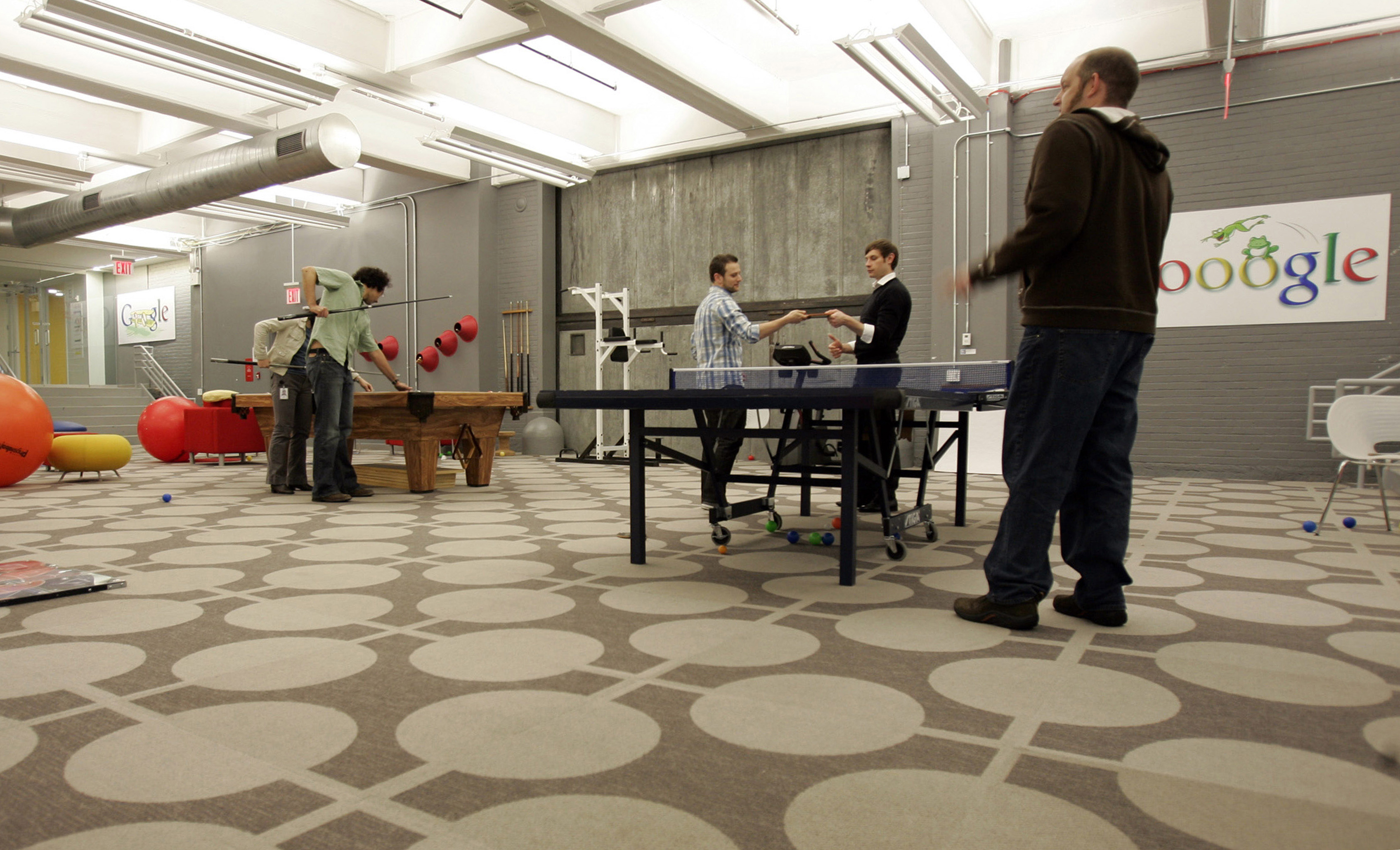"""Google employees play pool and ping pong in the """"Game Room"""" at the New York City company office"""