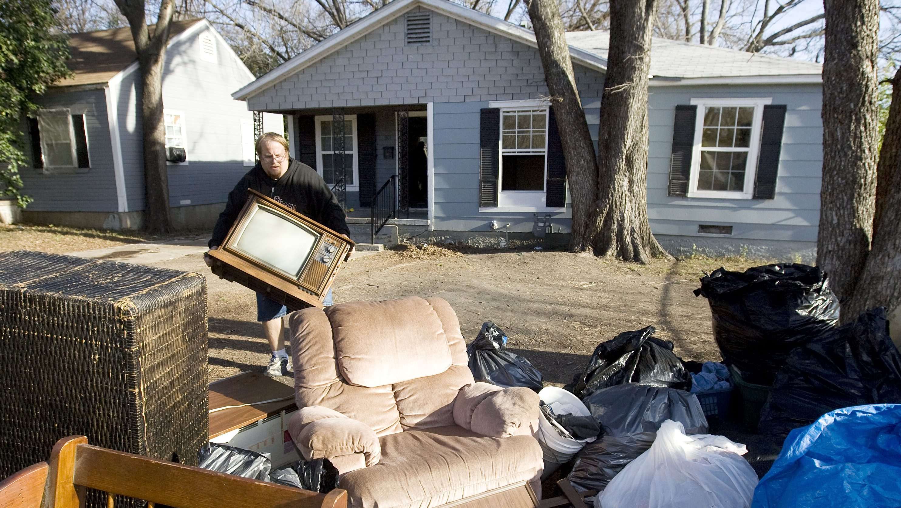 Family belongings put on curb during eviction proceeding from house in Waco, Texas