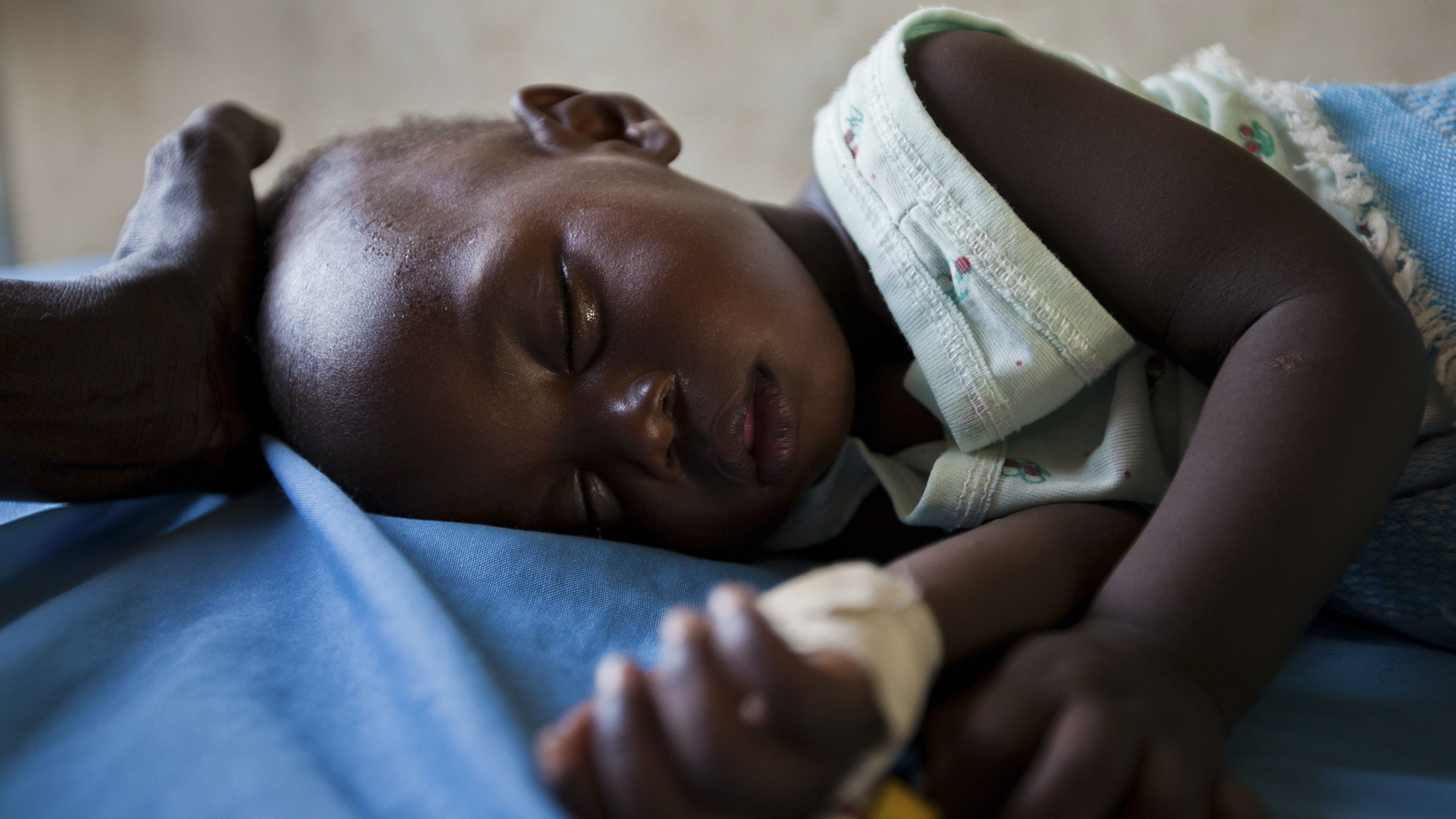 A young girl with malaria rests in the inpatient ward of the Malualkon Primary Health Care Center in Malualkon, in the South Sudanese state of Northern Bahr el Ghazal, June 1, 2012. As in many developing nations, international aid is both an invaluable help to South Sudan and a crutch that sometimes enables it to avoid reality. Development experts have grown more sophisticated in recent decades about how they deliver aid. But in fragile states such as South Sudan, getting the balance right between helping a country and helping that country help itself remains incredibly difficult. Picture taken June 1, 2012. To match Special Report SOUTH-SUDAN/AID REUTERS/Adriane Ohanesian (SOUTH SUDAN - Tags: ANNIVERSARY HEALTH SOCIETY TPX IMAGES OF THE DAY)