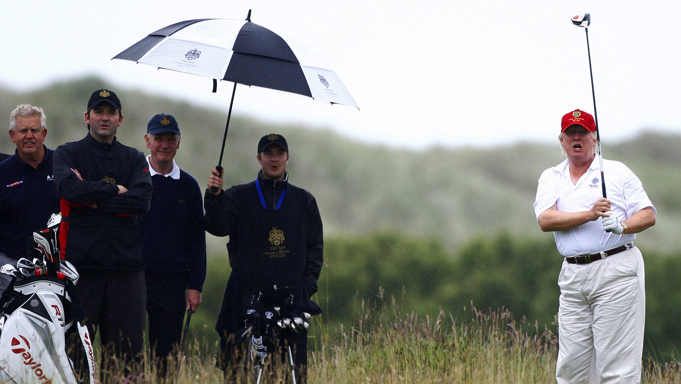 Real estate magnate Trump plays golf during the opening of his Trump International Golf Links golf course near Aberdeen, northeast Scotland