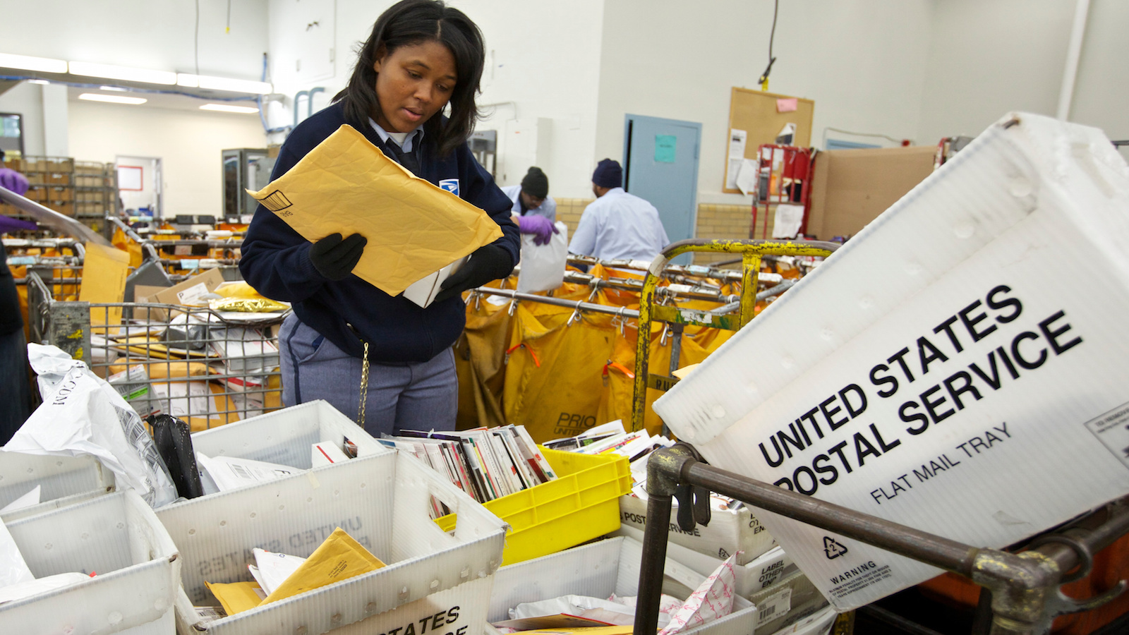 United States Postal Service (USPS) Letter Carrier Lakesha Dortch-Hardy sorts mail at the Lincoln Park carriers annex in Chicago, November 29, 2012. The USPS, which relies on the sale of stamps and other products rather than taxpayer dollars, has been grappling for years with high costs and tumbling mail volumes as consumers communicate more online.