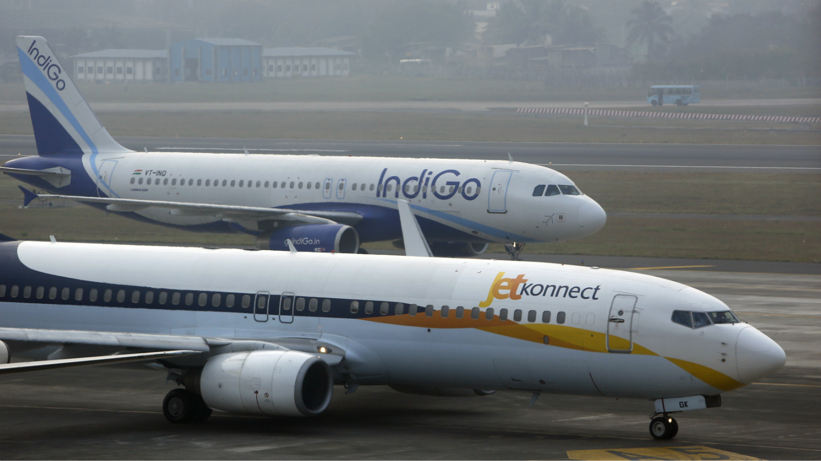 An IndiGo Airlines Airbust A320 aircraft and JetKonnect Boeing 737 aircraft taxi at Mumbai's Chhatrapathi Shivaji International Airport February 3, 2013. Picture taken February 3, 2013.