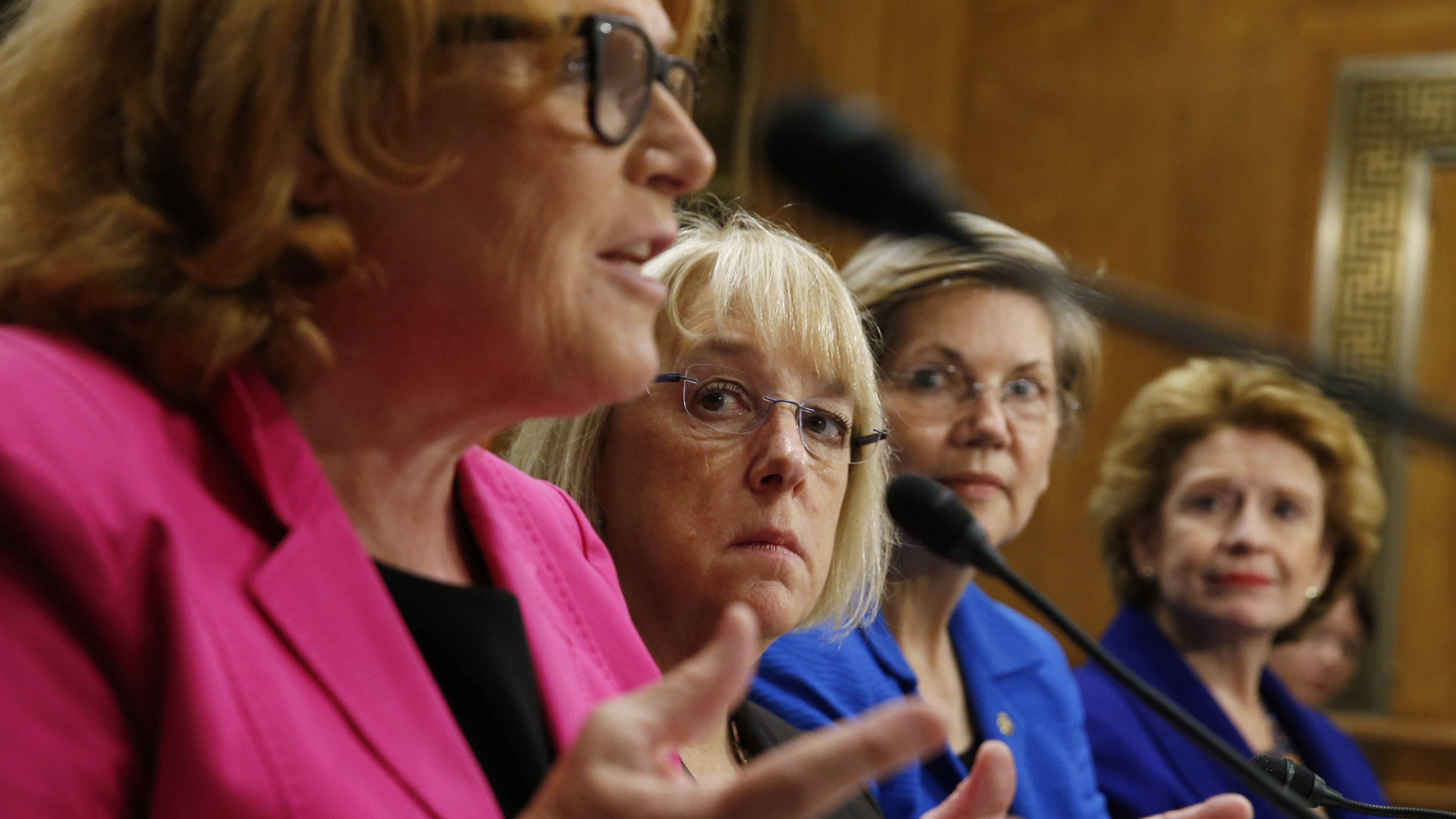 "Women senators testify during a Senate Foreign Relations sub-committee hearing on ""Combating Violence and Discrimination Against Women: A Global Call to Action"" on Capitol Hill in Washington June 24, 2014. From left are Senators Heidi Heitkamp, Patty Murray, Elizabeth Warren and Debbie Stabenow.  REUTERS/Kevin Lamarque  (UNITED STATES - Tags: POLITICS SOCIETY) - RTR3VHAC"