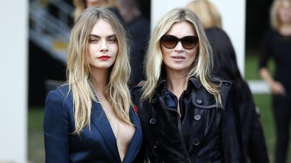 Models Cara Delevingne (L) and Kate Moss arrive to attend the presentation of the Burberry Spring/Summer 2015 collection during London Fashion Week September 15, 2014.