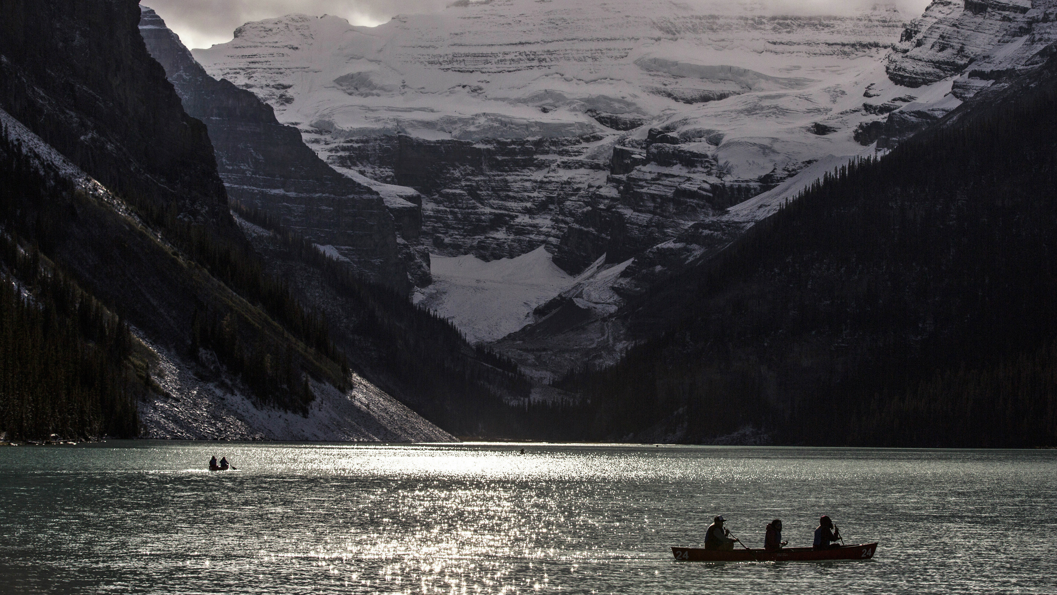 People canoe on Lake Louise at Banff National Park, in the Canadian Rocky Mountains outside the village of Lake Louise, Alberta, October 2, 2014.