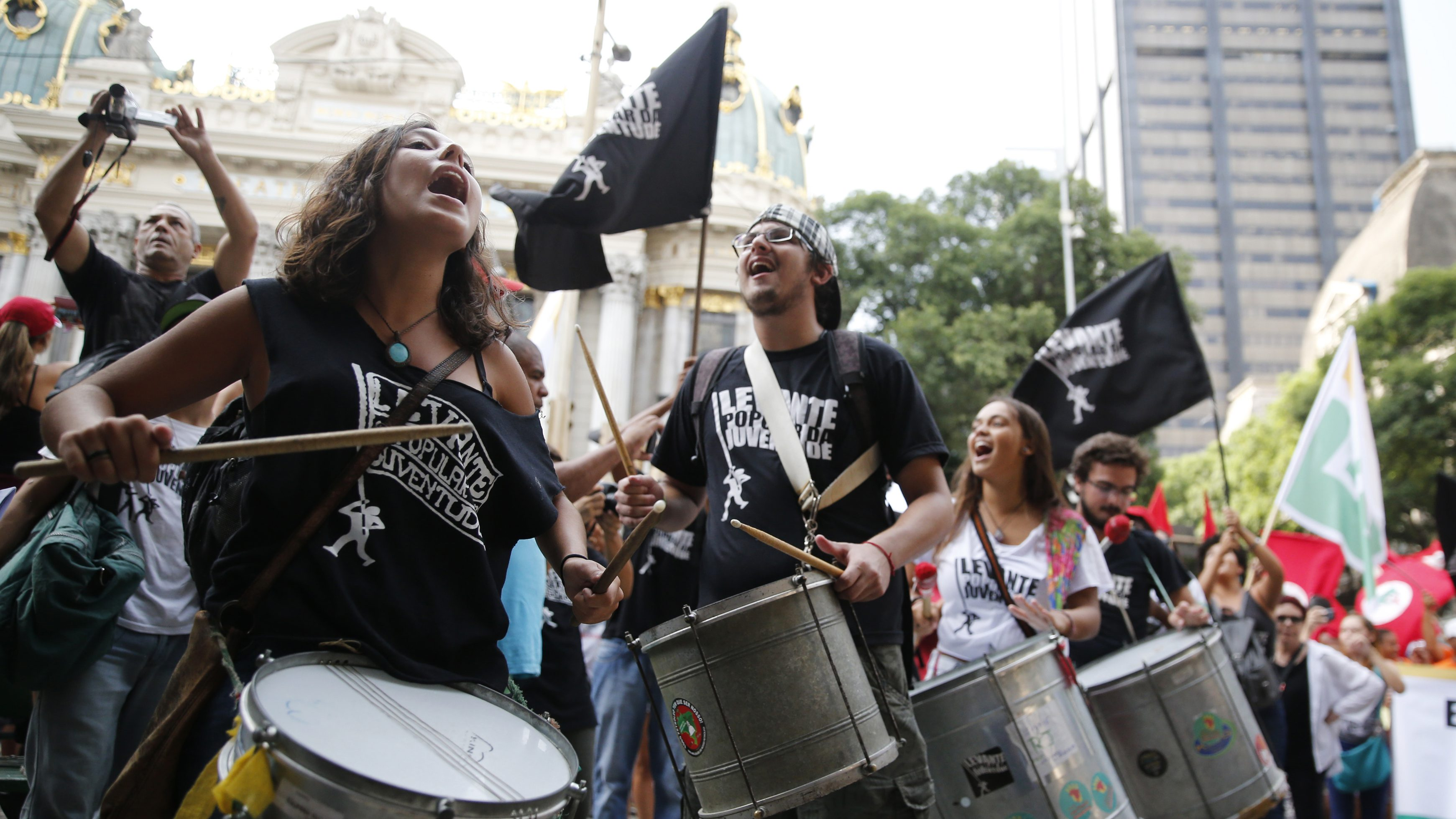 Students take part in a demonstration in defense of Brazil's President Dilma Rousseff and the state-run oil company Petrobras, in Rio de Janeiro