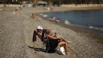 People enjoy sunny weather on a beach in the Mediterranean sea during Holy Week in Marbella, southern Spain March 31, 2015. REUTERS/Jon Nazca - RTR4VN8H