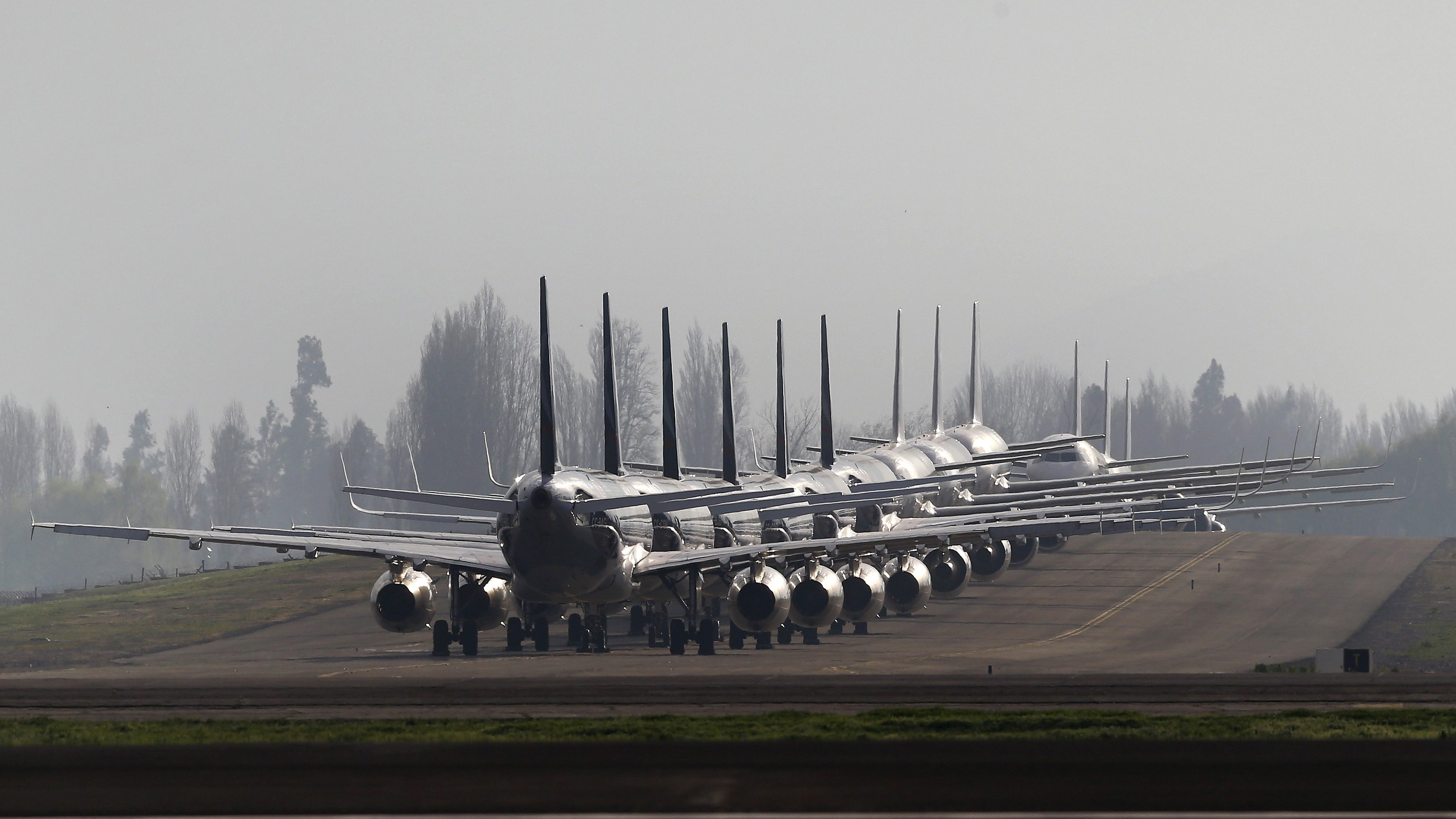 Planes are parked next to a landing track at the international airport of Santiago city, Chile, September 15, 2015.