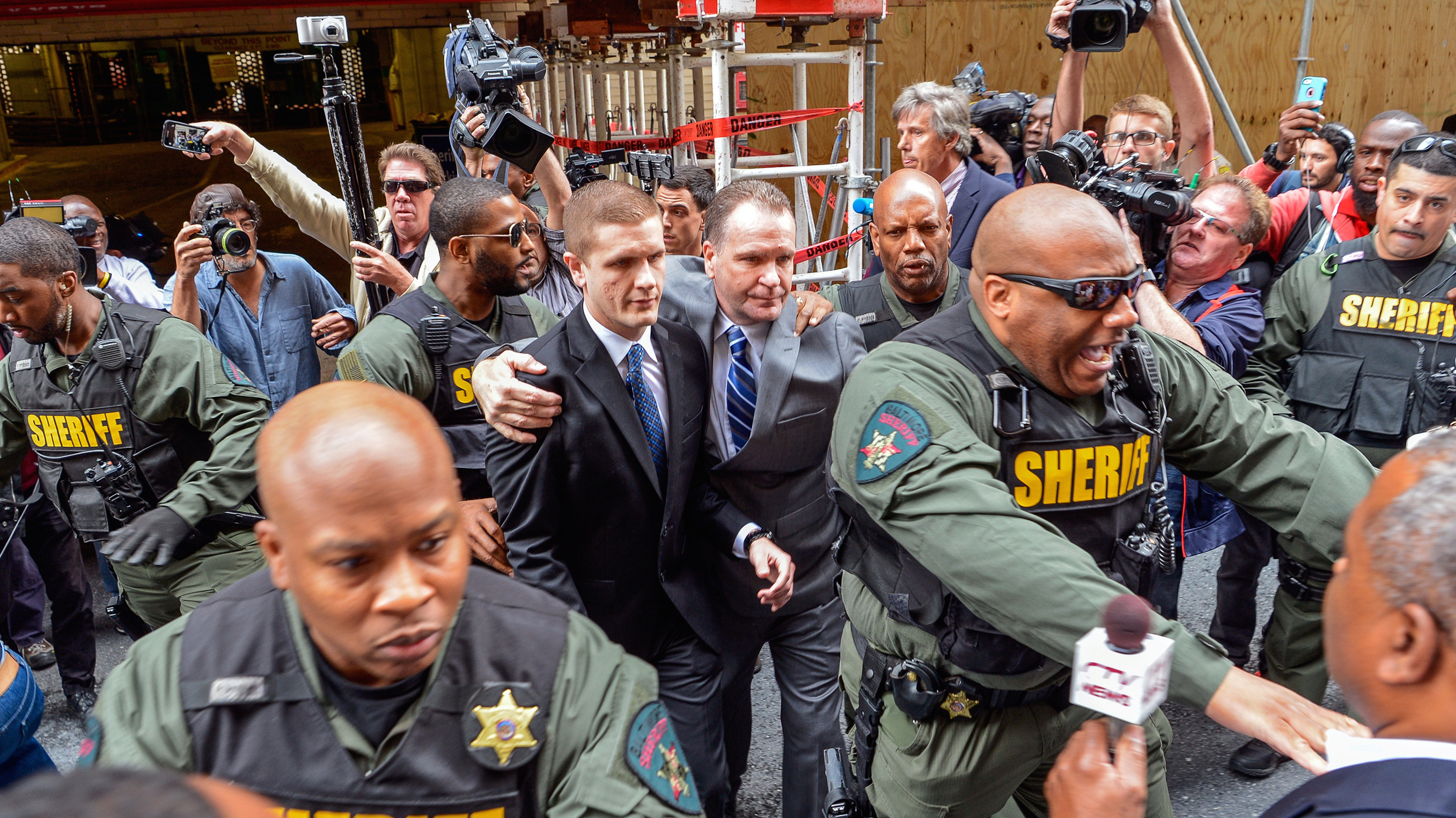 Sheriff deputies escort the family of police officer Edward Nero from the courthouse in Baltimore