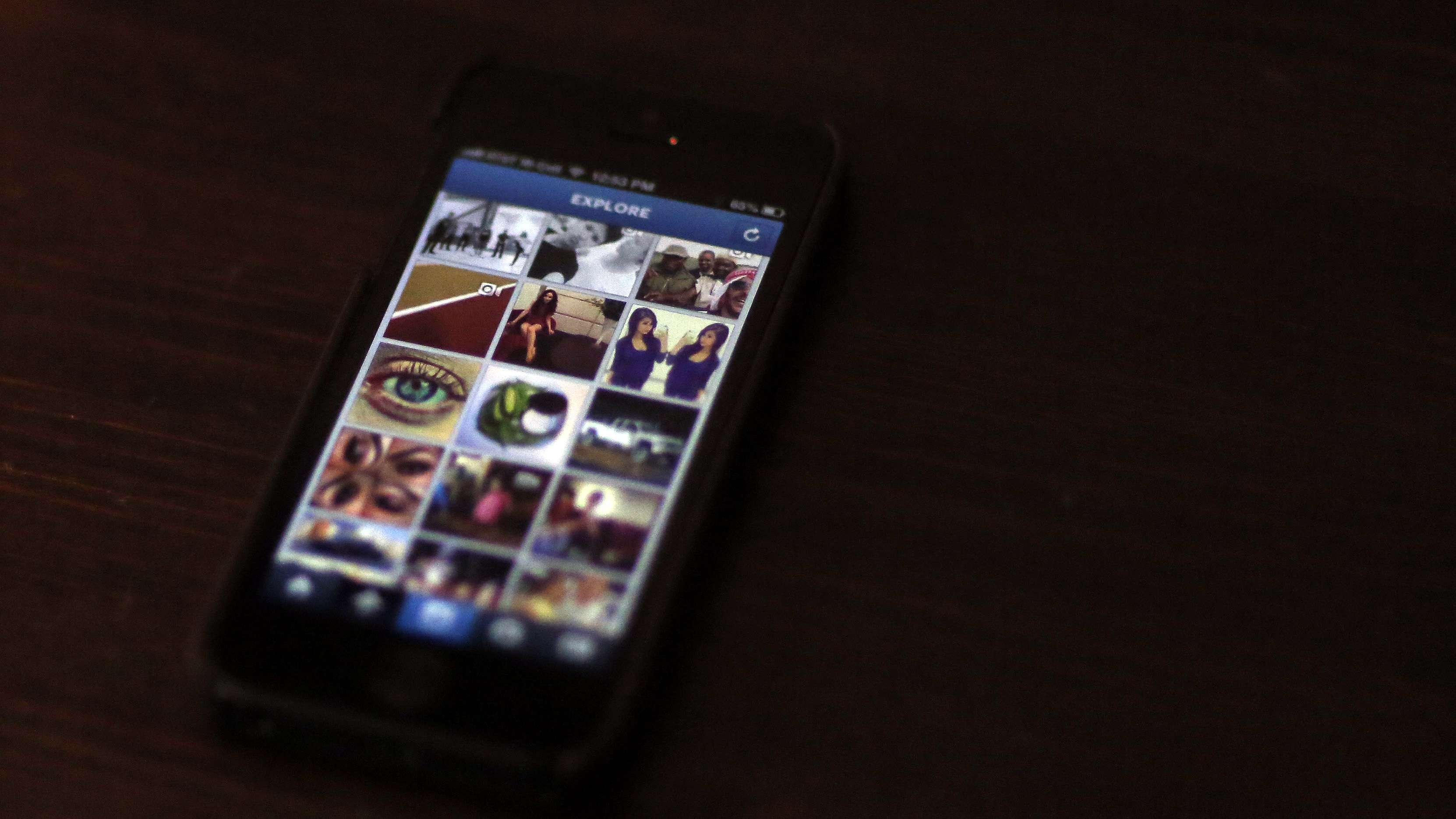 A most popular Instagram page is displayed on a mobile device screen in Pasadena, California August 14, 2013.