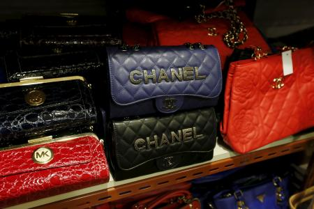 Counterfeit handbags are displayed at the Customs headquarters in Hong Kong, China, August 6, 2015. Customs and police smashed a syndicate suspected of selling counterfeit goods, seizing more than 30,000 items, the largest amount in a decade. One Filipino and two Pakistainis were arrested, customs and police officers said. REUTERS/Bobby Yip - RTX1N9X6