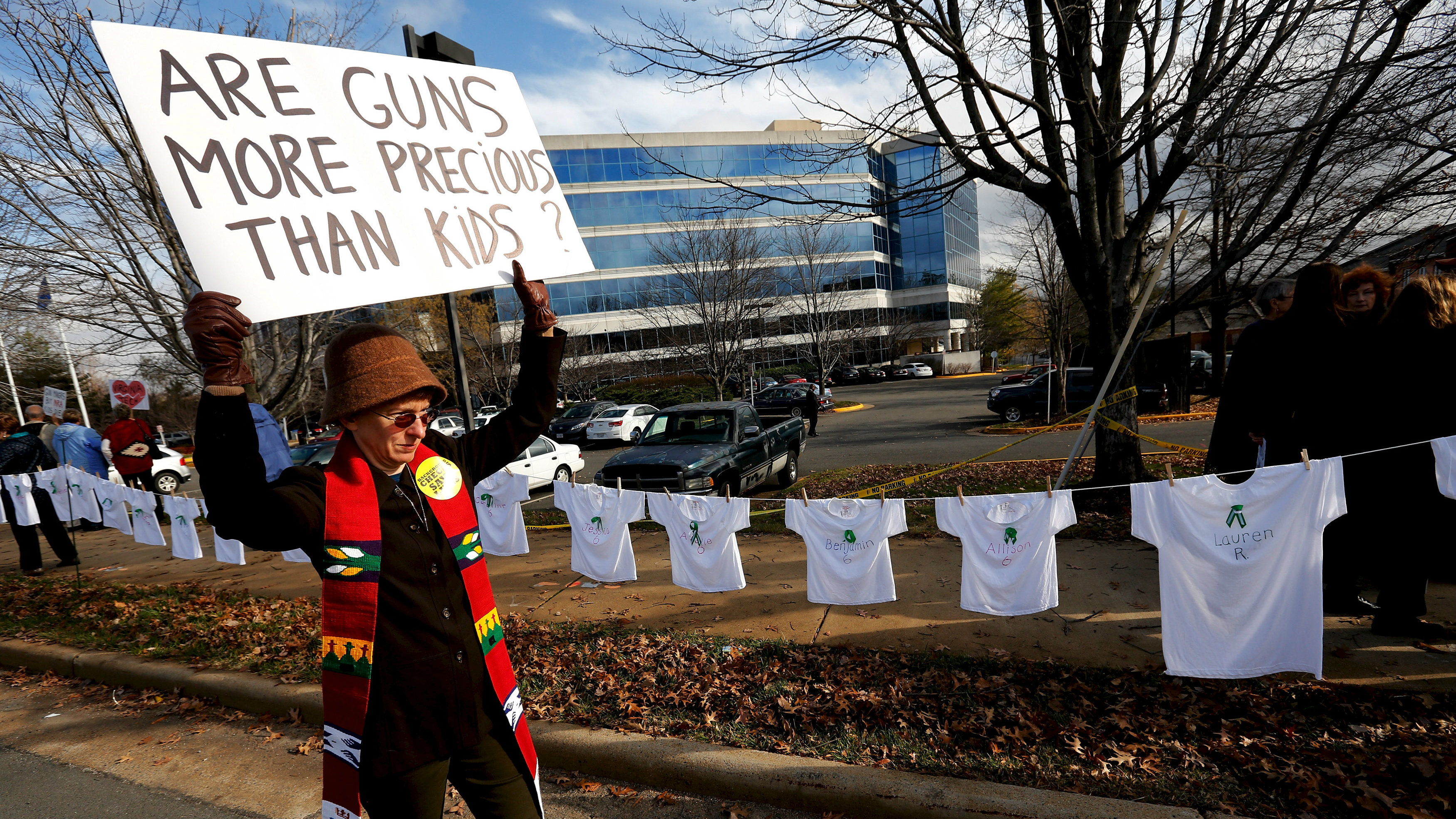 Activists hold a protest and vigil on the third anniversary of the Sandy Hook mass shooting, outside...