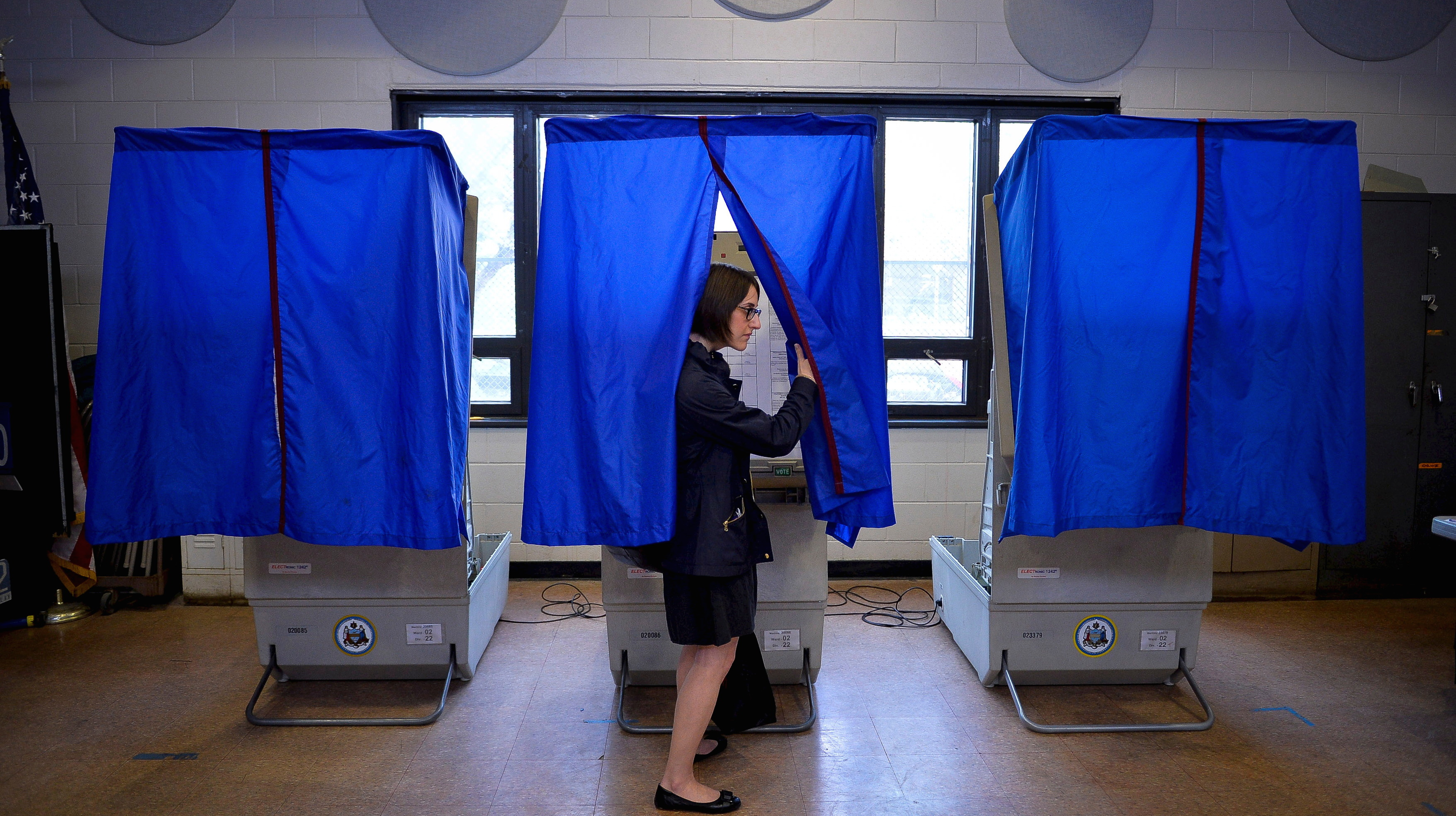 File photo of a voter leaving the booth after casting her ballot in the Pennsylvania primary at a polling place in Philadelphia