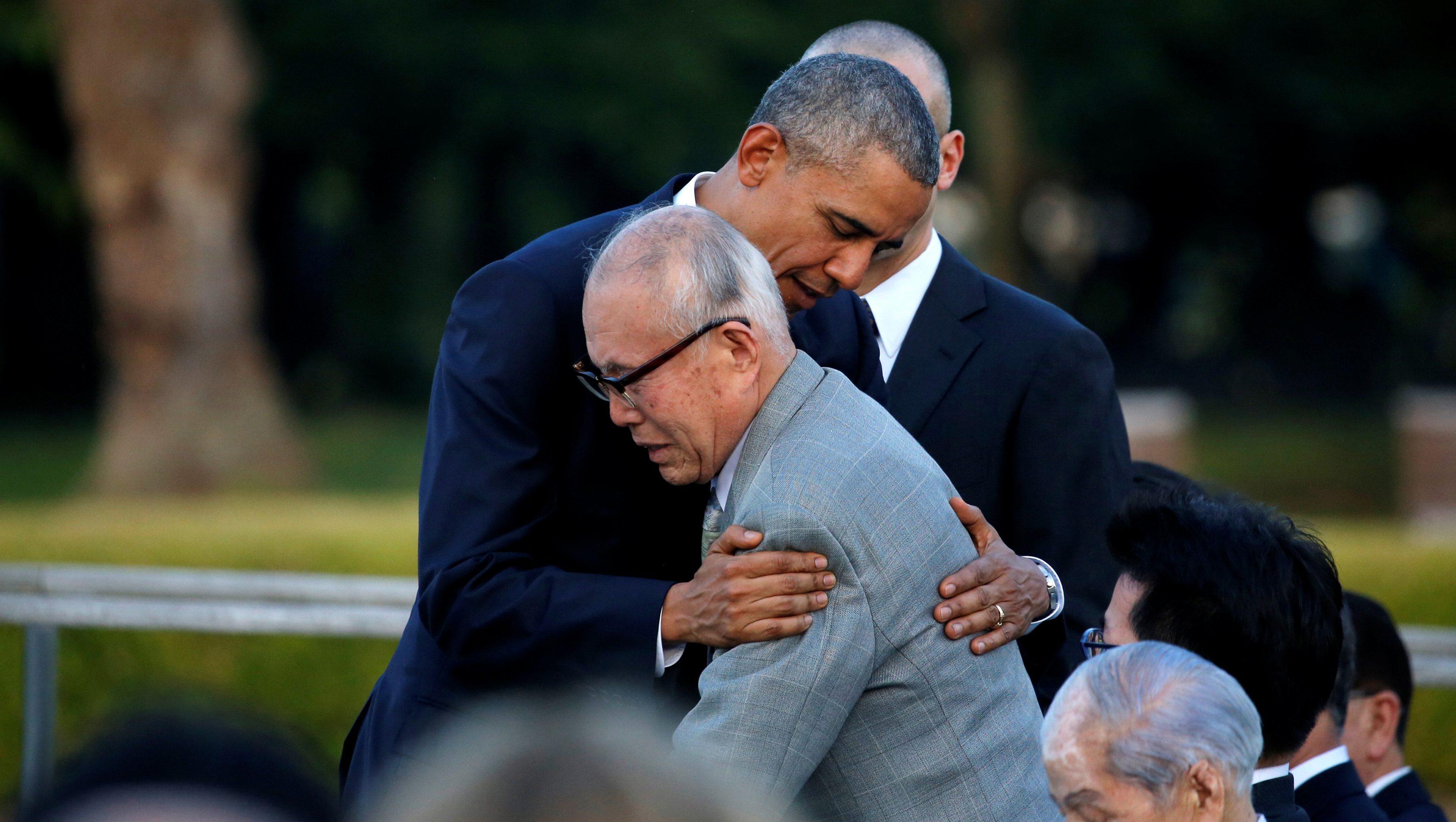 U.S. President Obama hugs atomic bomb survivor Shigeaki Mori as he visits Hiroshima Peace Memorial Park in Hiroshima, Japan