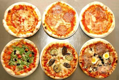 Various pizzas made in an Italian restaurant in Pyongyang are displayed in this picture released by North Korea's official KCNA news agency on April 28, 2009. KCNA said this picture was taken on April 28, 2009. REUTERS/KCNA (NORTH KOREA MILITARY FOOD SOCIETY POLITICS) QUALITY FROM SOURCE. NO THIRD PARTY SALES. NOT FOR USE BY REUTERS THIRD PARTY DISTRIBUTORS - RTXEHP5
