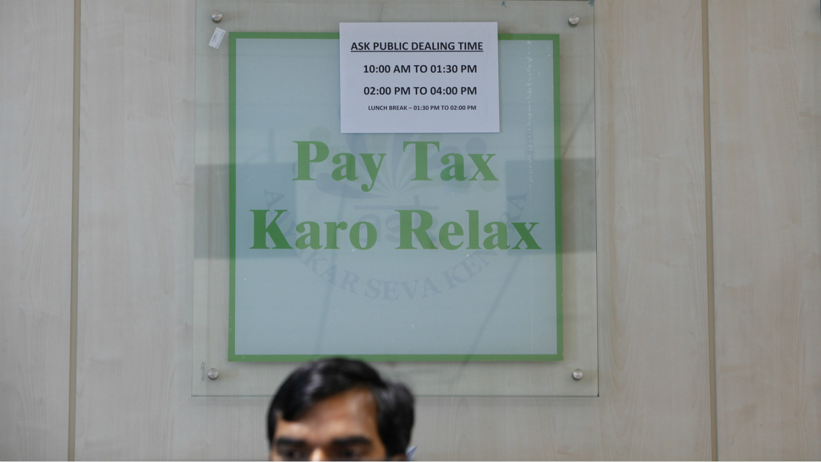 An employee works inside Income Tax office in New Delhi April 5, 2013. Indian tax officials have opened up a new front in their battle to increase revenue collected from companies, targeting manufacturing firms that slash prices below cost in order to sell slow-moving inventory. Picture taken April 5.