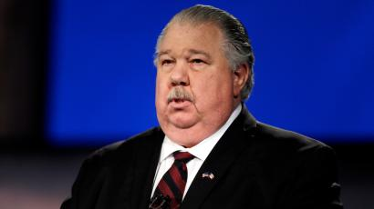 Iowa Republican senatorial candidate college professor Sam Clovis looks on before a live televised debate at Iowa Public Television studios, Thursday, April 24, 2014, in Johnston, Iowa.
