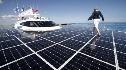 A woman walks on the deck of the world's largest solar-powered boat in Cancun, Mexico.