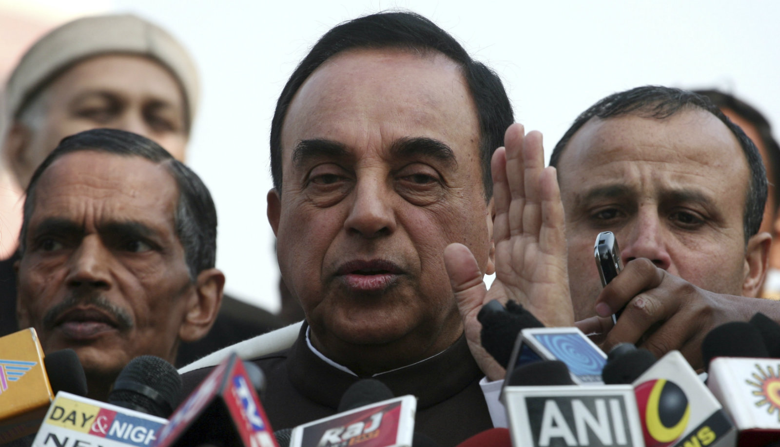 Subramanian Swamy, an opposition politician who brought the petition to revoke the telecom licences issued in 2008, speaks with the media after a verdict outside the Supreme Court in New Delhi February 2, 2012. India's Supreme Court on Thursday revoked all 122 telecoms licences issued under a scandal-tainted 2008 sale, a fresh embarrassment for the government and plunging the mobile network market of Asia's third-largest economy into uncertainty.
