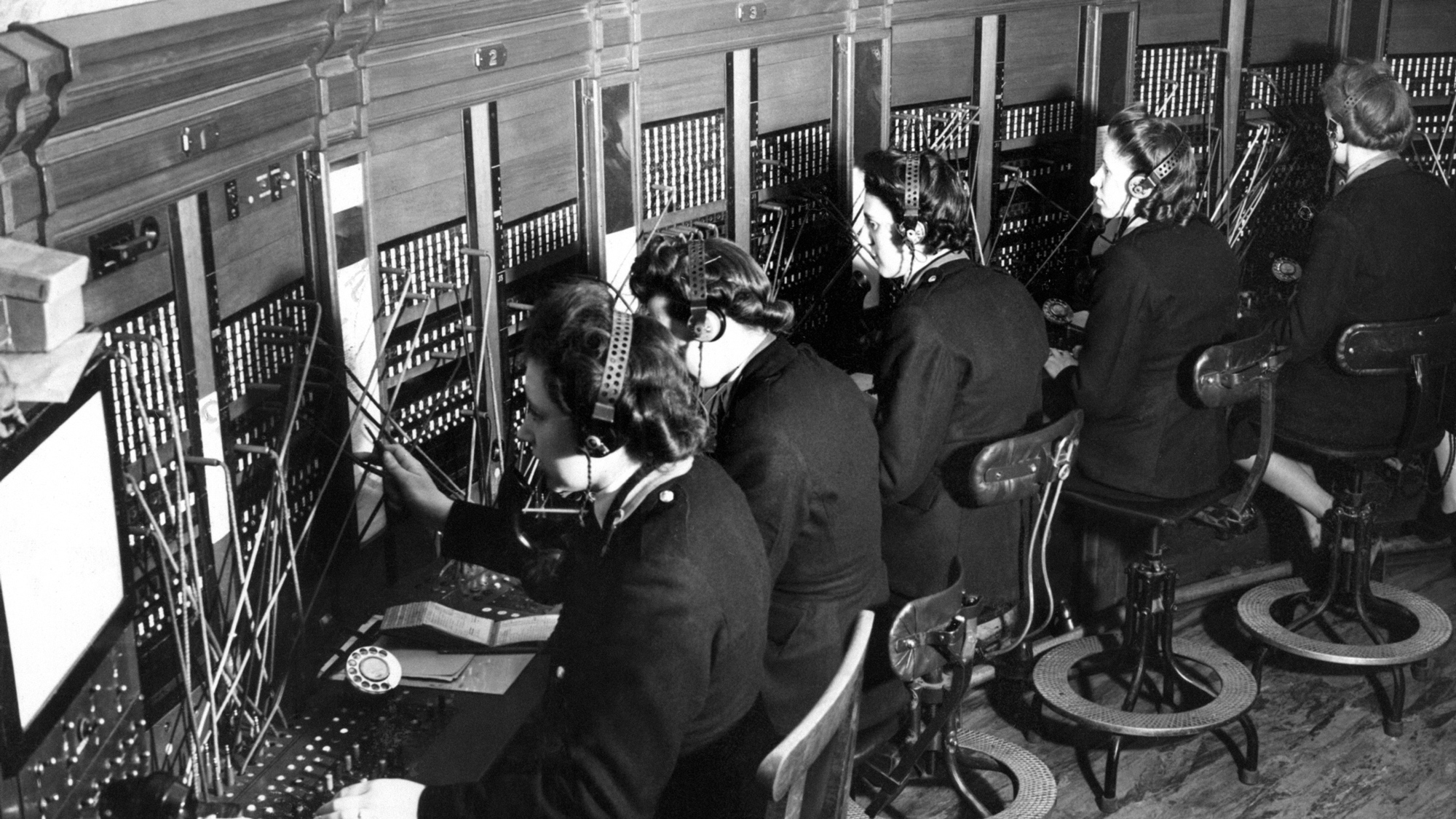 At the London Region fire control room, battle H.Q. of the National Fire Service. In the fight against the fire attacks by the Luftwaffe on London, the course of the raid is followed by telephone reports from all over the Metropolis. Reports of fires and the progress of the raiding are plotted on large scale maps and movement of firefighting reinforcements is ordered accordingly. Switchboard operators in action in London March 20, 1944. This switchboard is the nerve centre through which the operations officer receives reports of fires and the progress of raiding and through which the issues his orders to the areas where the fire battle is being fought. (AP Photo)
