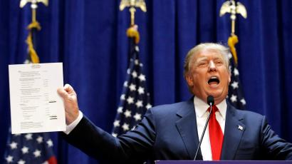 U.S. Republican presidential candidate, real estate mogul and TV personality Donald Trump holds up his financial statement showing his net worth as he formally announces his campaign for the 2016 Republican presidential nomination during an event at Trump Tower in New York June 16, 2015.