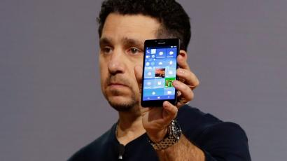 Microsoft vice president for Surface Computing Panos Panay shows a new Lumia 950 phone during a presentation, in New York, Tuesday, Oct. 6, 2015. The device will work with an optional dock. Users can attach a regular monitor, keyboard and mouse and work with apps on the phone just like you would on a Windows 10 desktop. (AP Photo/Richard Drew)