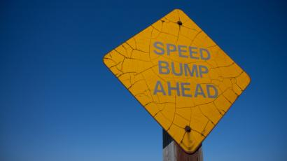 "A sign reading ""Speed Bump Ahead"""