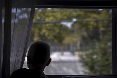 5-year-old Baraka Cosmas Lusambo from Tanzania looks out the window in the Staten Island borough of New York, September 21, 2015. Albino body parts are highly valued in witchcraft and can fetch a high price. Superstition leads many to believe albino children are ghosts who bring bad luck. Some believe the limbs are more potent if the victims scream during amputation, according to a 2013 United Nations report. Albinism is a congenital disorder affecting about one in 20,000 people worldwide who lack pigment in their skin, hair and eyes. It is more common in sub-Saharan Africa and affects about one Tanzanian in 1,400. United Nations officials estimate about 75 albinos have been killed in the east African nation since 2000 and have voiced fears of rising attacks ahead of this year's election, as politicians seek good luck charms from witch doctors. Picture taken September 21, 2015. REUTERS/Carlo Allegri - RTS2I7H