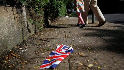 British flag which was washed away by heavy rains the day before lies on the street in London, Britain, June 24, 2016 after Britain voted to leave the European Union in the EU BREXIT referendum.