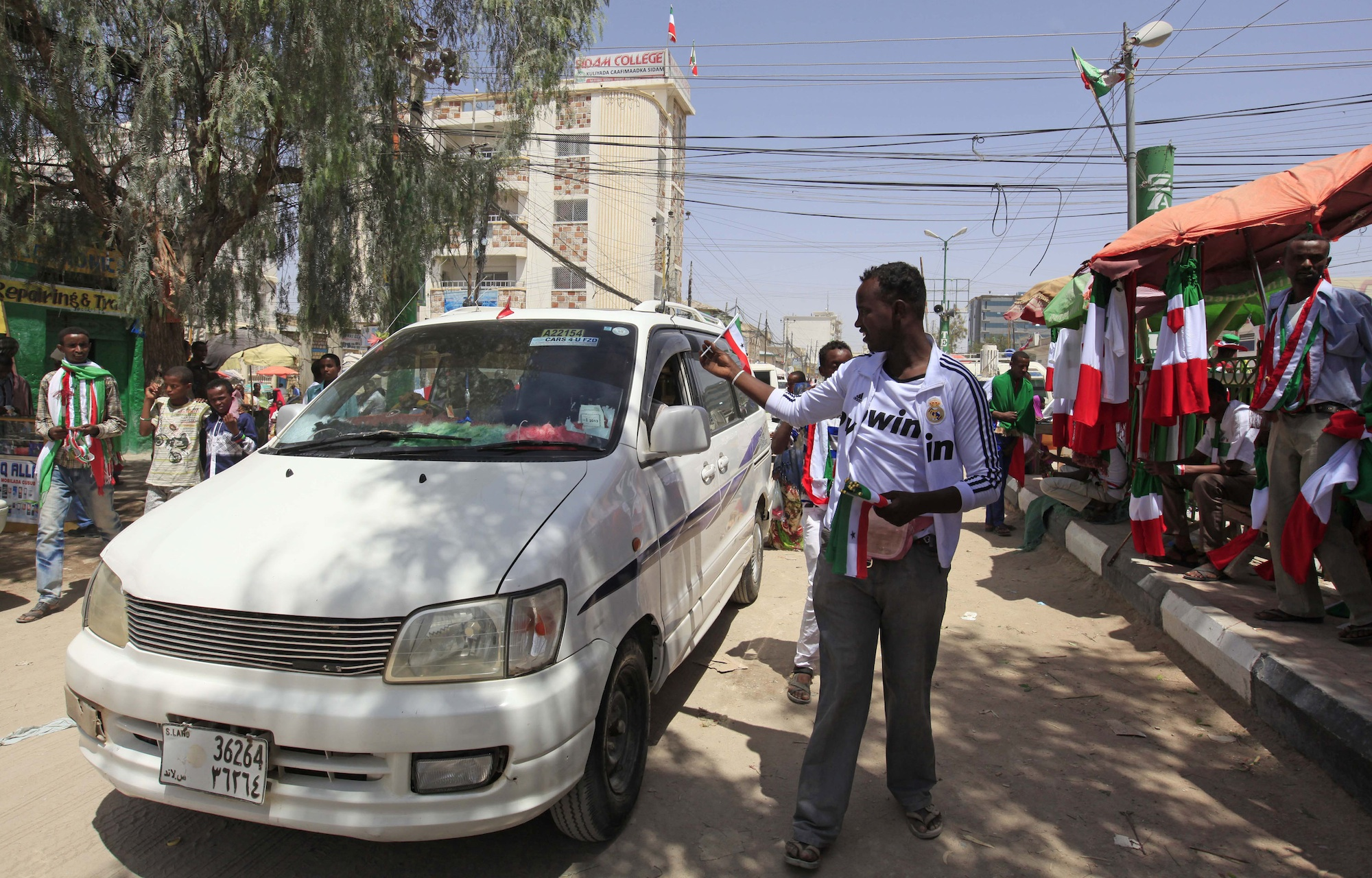 A man sells a flag a day before self-declared independence day of the breakaway Somaliland region, in Hargeisa