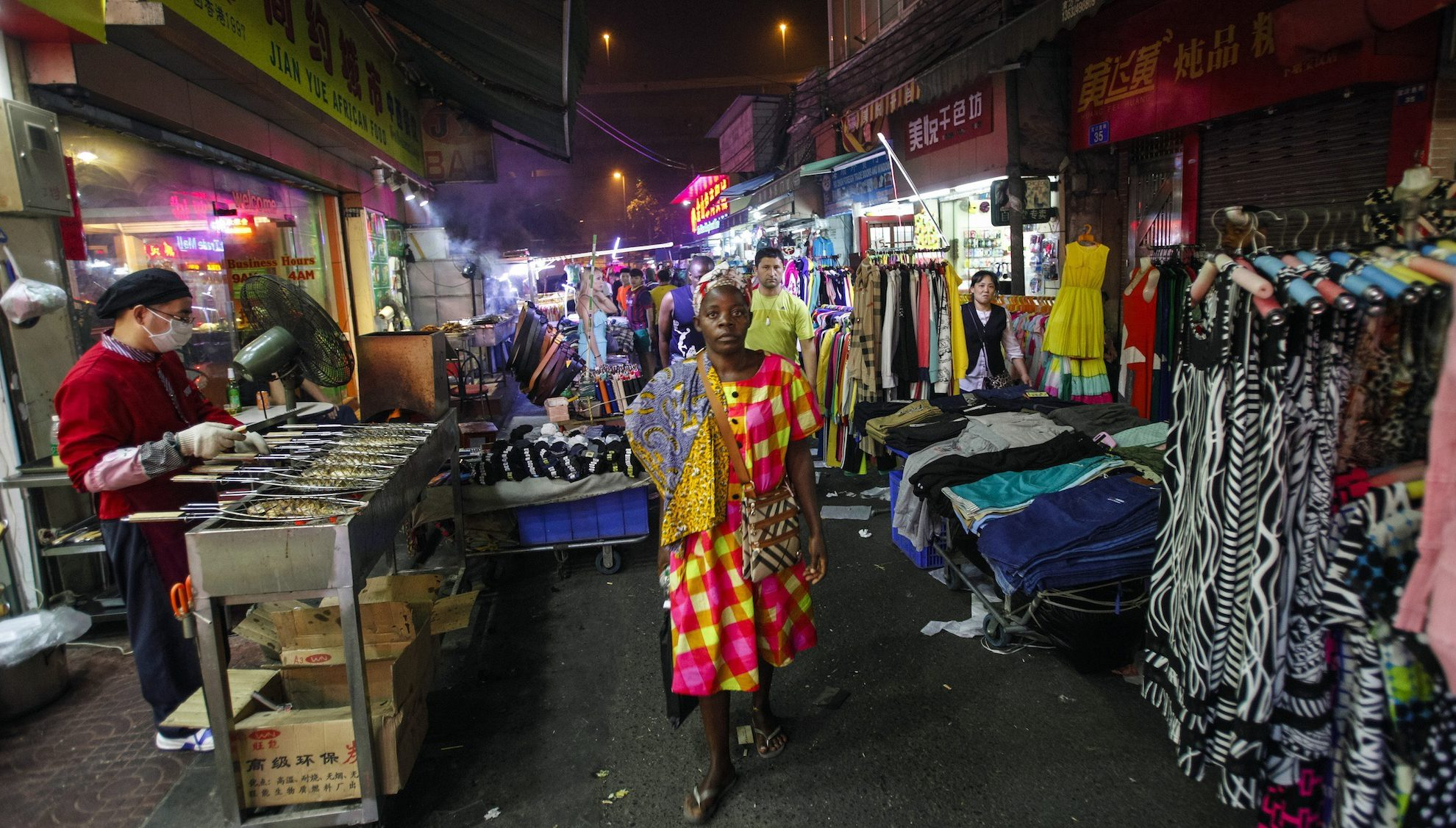 "Woman walks at a market in the ""African village"" in Guangzhou"