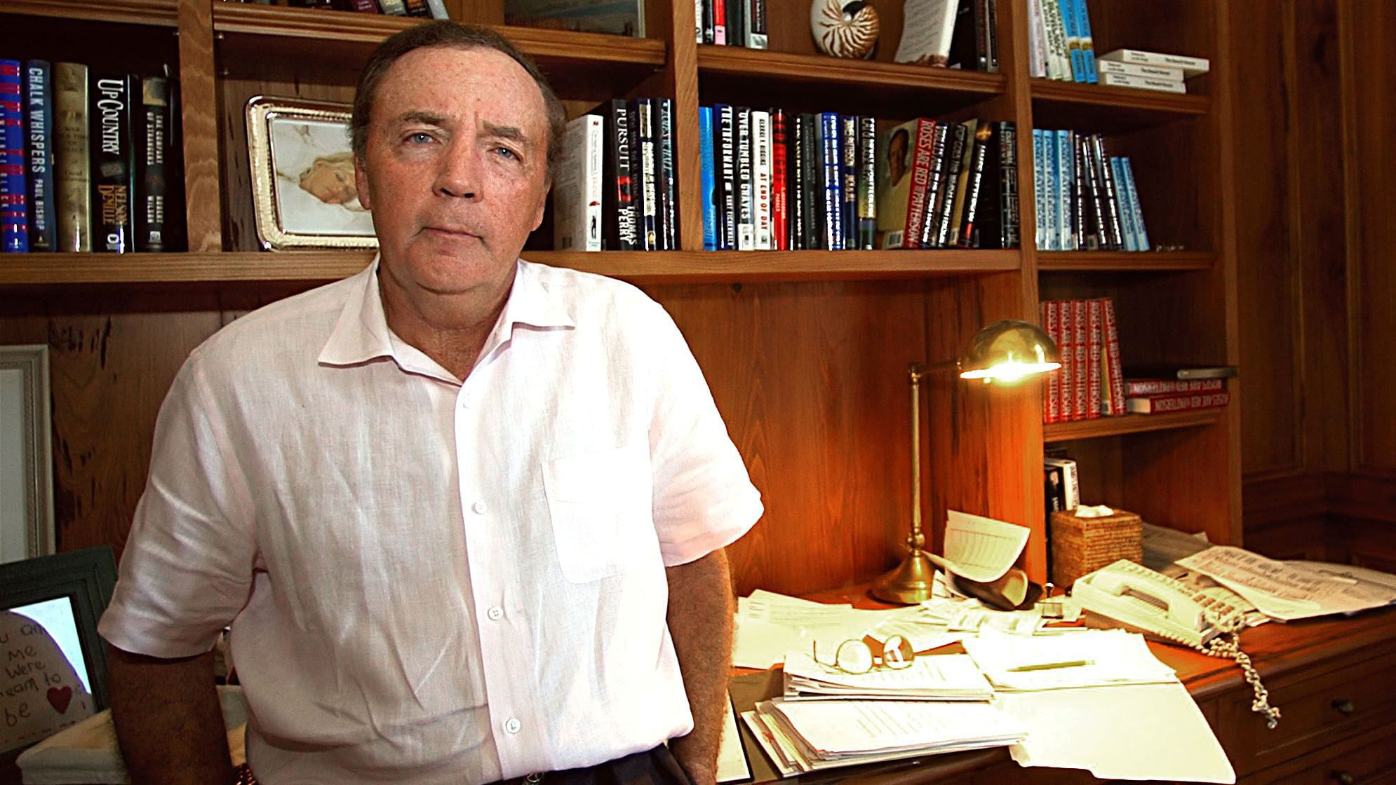 """FILE- This Feb. 28, 2003 file photo shows author James Patterson, of Palm Beach Fla, posing in his study.  Patterson's latest best-seller, """"The Angel Experiment,"""" is a little different from his usual hits. The novel isn't new; it came out four years ago. Its sales aren't happening at bookstores, but mostly on the Kindle store at Amazon.com. And the price is low even for an old release: $0.00 (AP Photo/ Steve Mitchell)"""