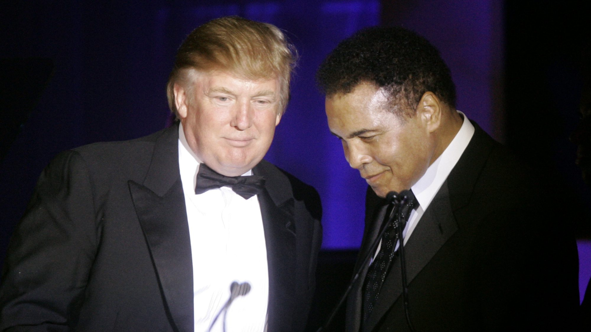 Donald Trump, left, accepts his Muhammad Ali award from Ali at Muhammad Ali's Celebrity Fight Night XIII in Phoenix, Ariz., Saturday, March 24, 2007. ()