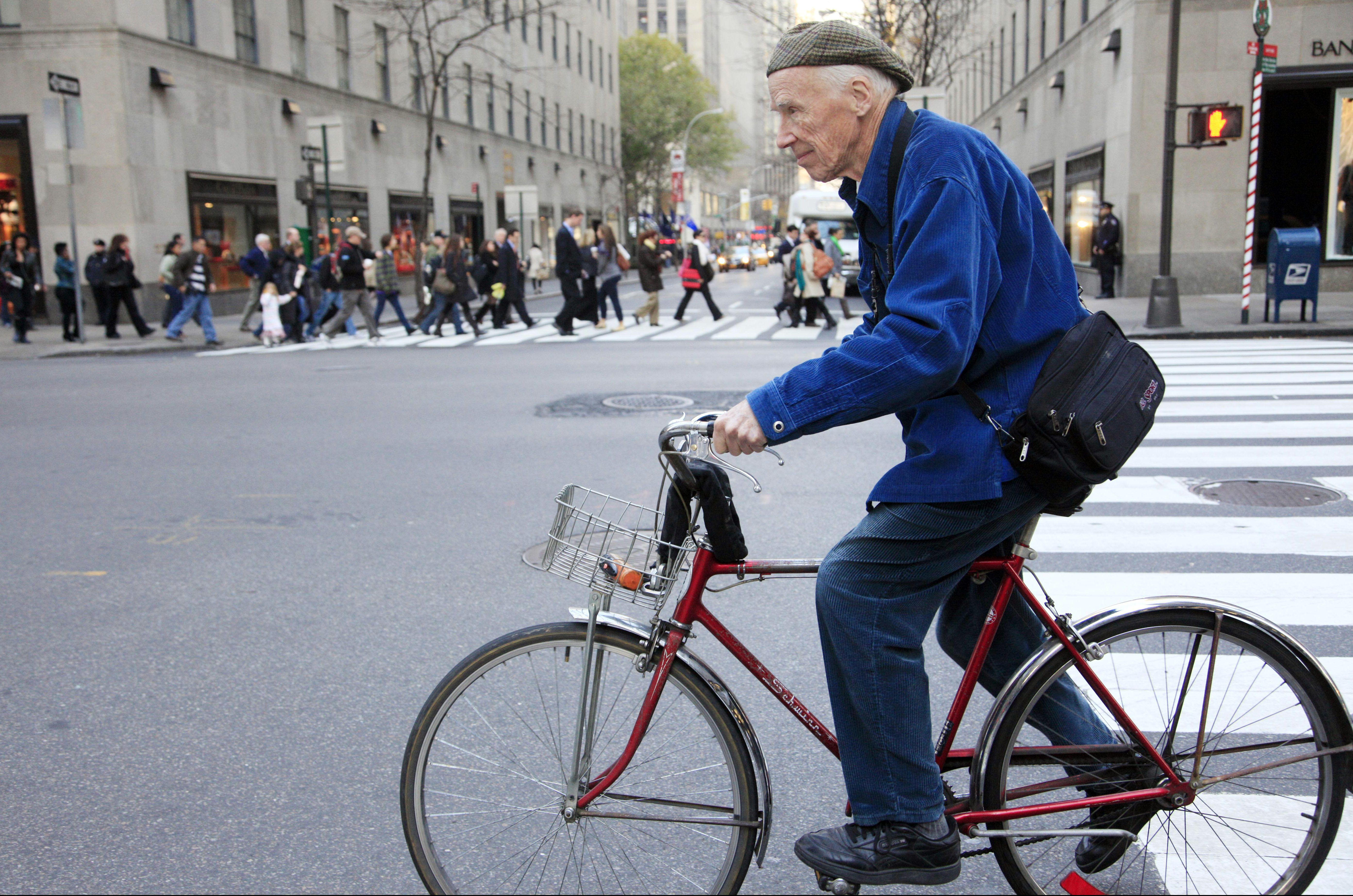 New York Times photographer Bill Cunningham bicycles to work, Tuesday, Nov. 23, 2010 in New York. (AP Photo/Mark Lennihan)