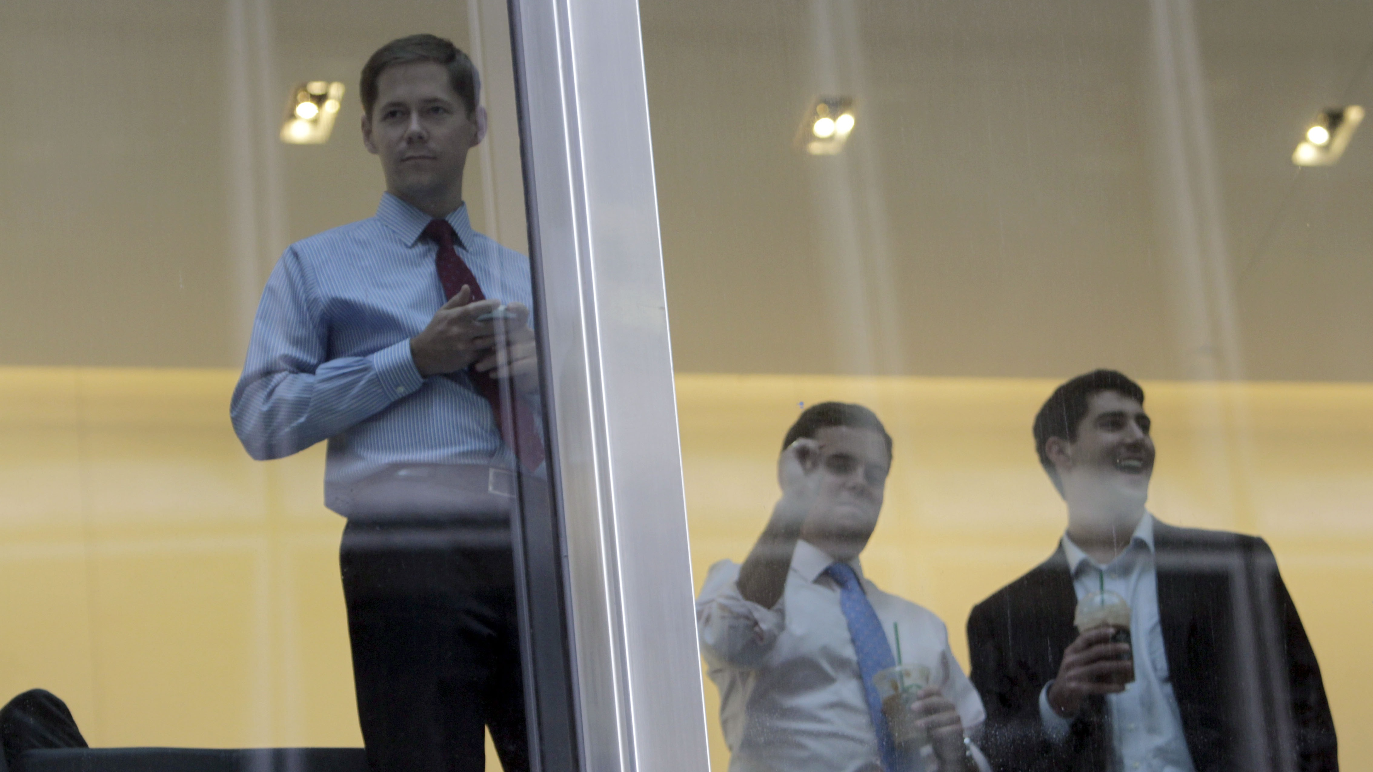 J.P. Morgan Chase employees watch as protestors associated with the Occupy Wall Street movement rally before delivering letters to the corporate headquarters intended for CEO Jamie Dimon, Friday, Oct. 28, 2011, in New York. (AP Photo/Mary Altaffer)