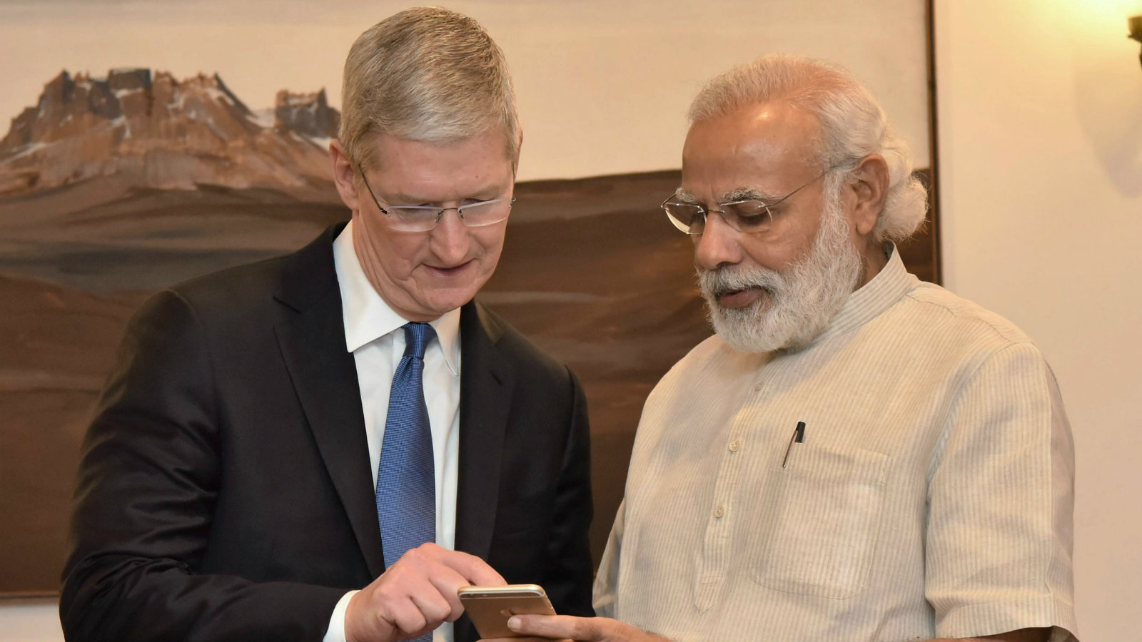 "In this photo released by the Press Information Bureau of India, Indian Prime Minister Narendra Modi, right, meets Apple CEO Tim Cook, in New Delhi, India, Saturday, May 21, 2016. Apple CEO Tim Cook laid out his company's plans for the vast Indian market in a meeting Saturday with Prime Minister Narendra Modi, who in turn sought Apple's support for his ""Digital India"" initiative focusing on e-education, health and increasing farmers' incomes."