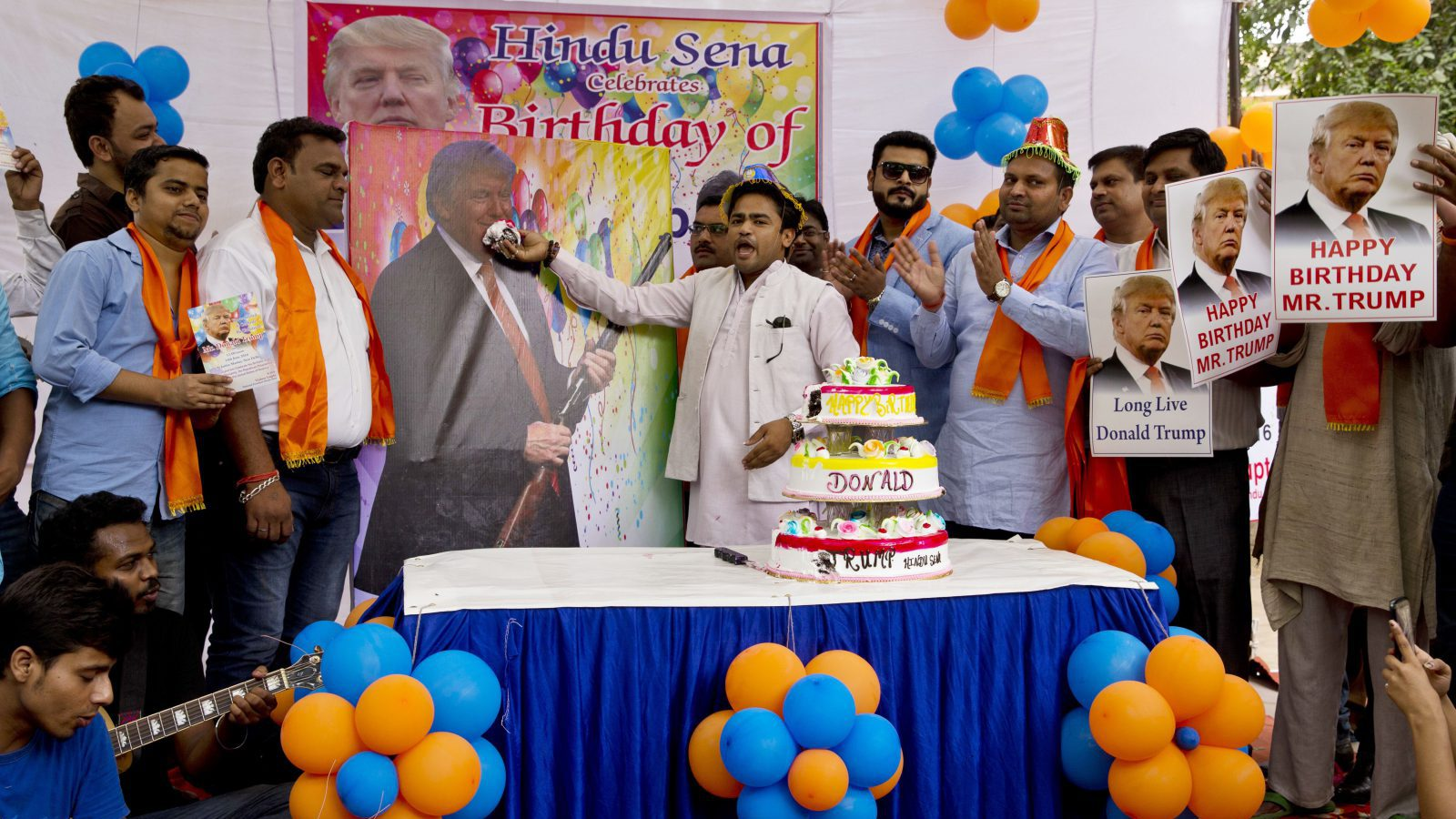 Members of Hindu nationalist party 'Hindu Sena' or Hindu Army, celebrate the birthday of U.S. presidential candidate Donald Trump in New Delhi, India, Tuesday, June 14, 2016.