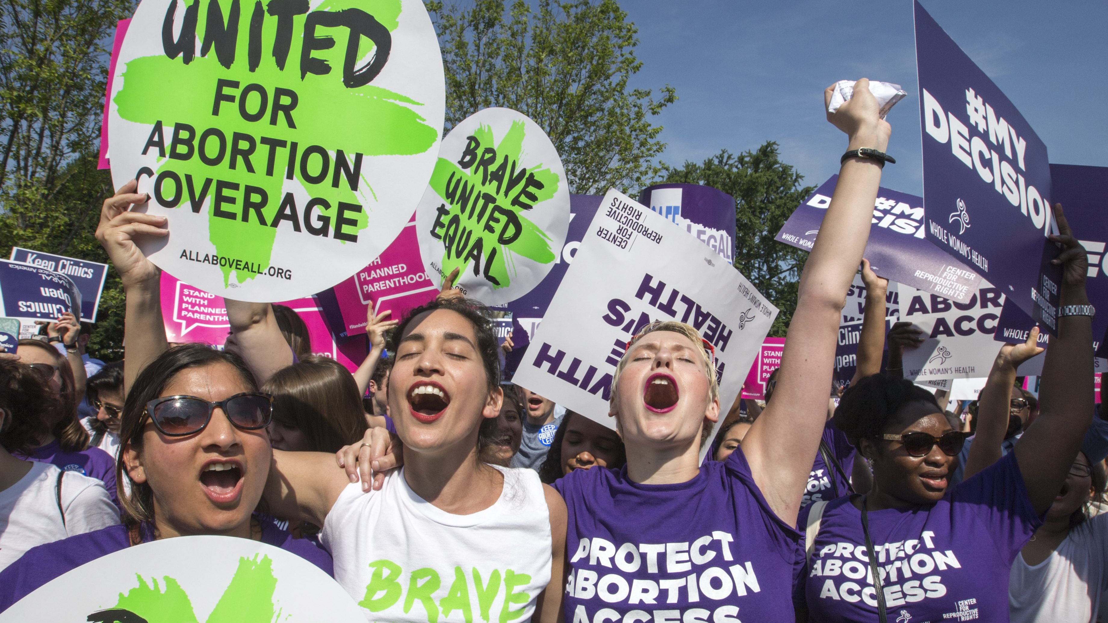Abortion rights activists, from left, Ravina Daphtary of Philadelphia, Morgan Hopkins of Boston, and Alison Turkos of New York City, rejoice in front of the Supreme Court in Washington, Monday, June 27, 2016, as the justices struck down the strict Texas anti-abortion restriction law known as HB2. Other cases are to follow on guns, and public corruption. ()