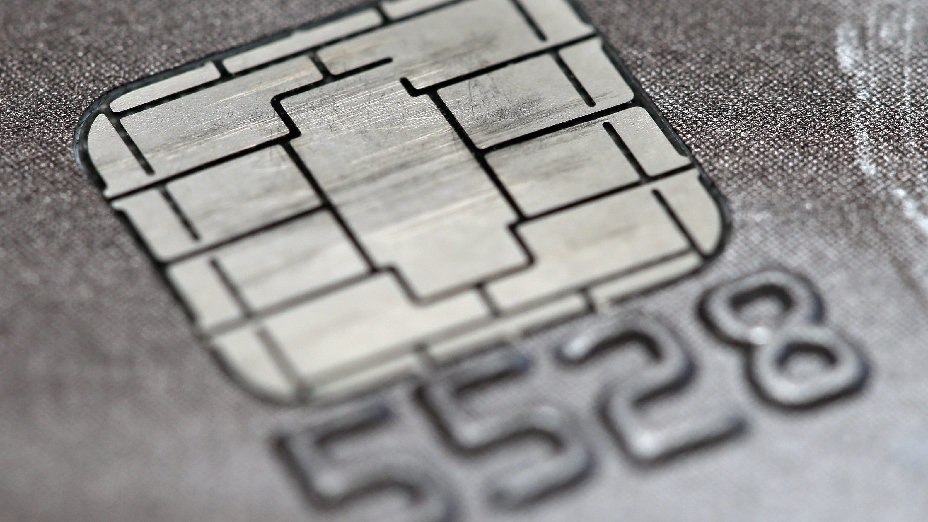 FILE -This June 10, 2015 photo shows a chip credit card in Philadelphia.   Visa says its improving its smart chip-embedded cards, which have been the source of grumbling from businesses and customers forced to wait for transactions to go through. The company said Tuesday, April 19, 2016 that Quick Chip for EMV will let customers dip and remove cards, usually in two seconds or less, without waiting for purchases to be finalized.