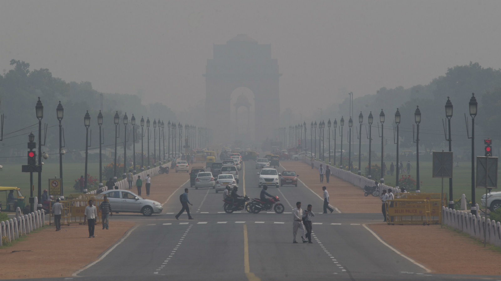 India Gate, one of the landmarks of central Delhi, is barely visible through thick smog in New Delhi, India, Monday, Nov. 9, 2015. Delhi's air quality has been hitting new lows over the past week and authorities are urging people to refrain from lighting smoke emanating firecrackers during the upcoming Diwali festival.