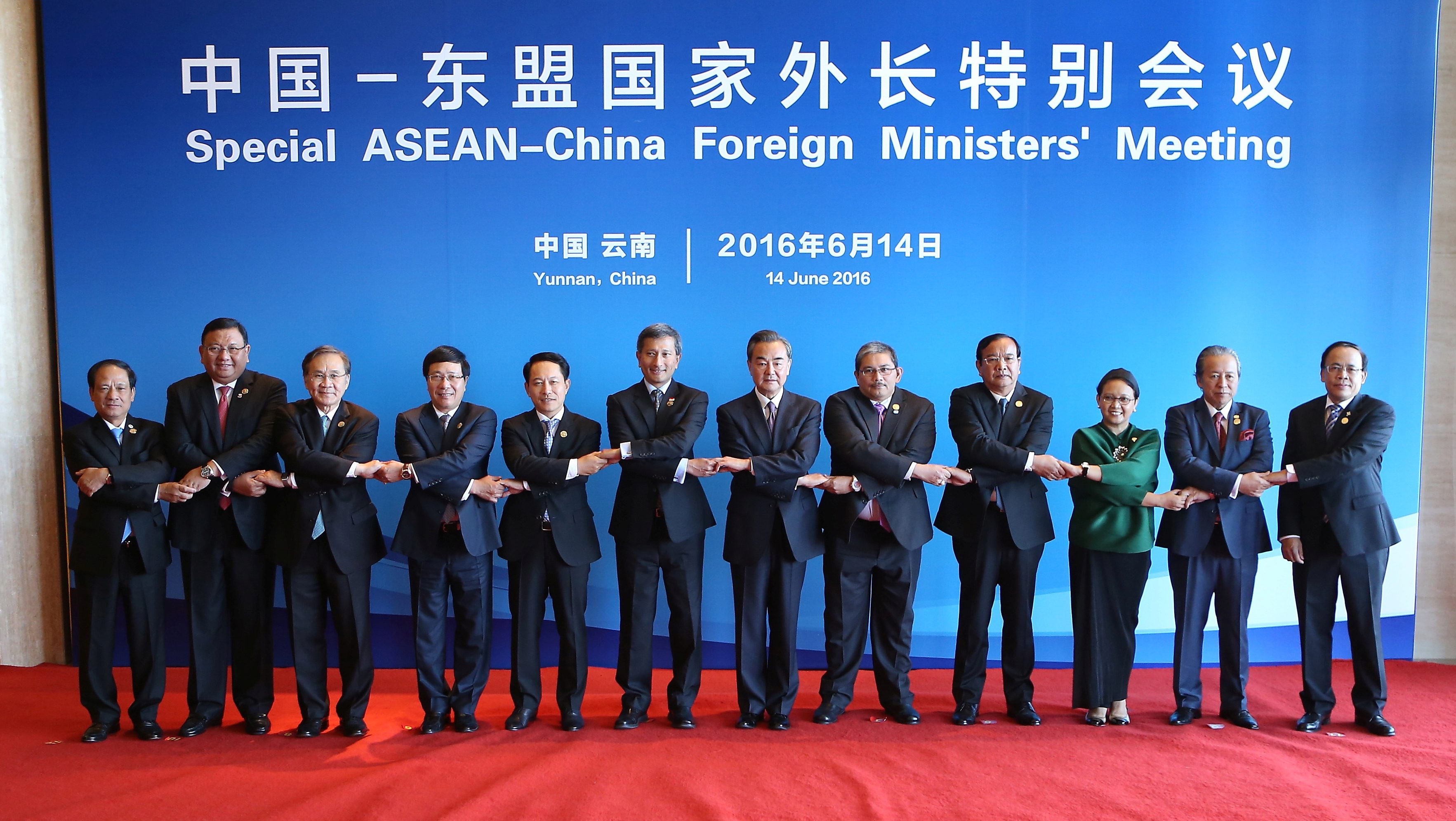Officials pose for pictures during the Special ASEAN-China Foreign Ministers' Meeting in Yuxi
