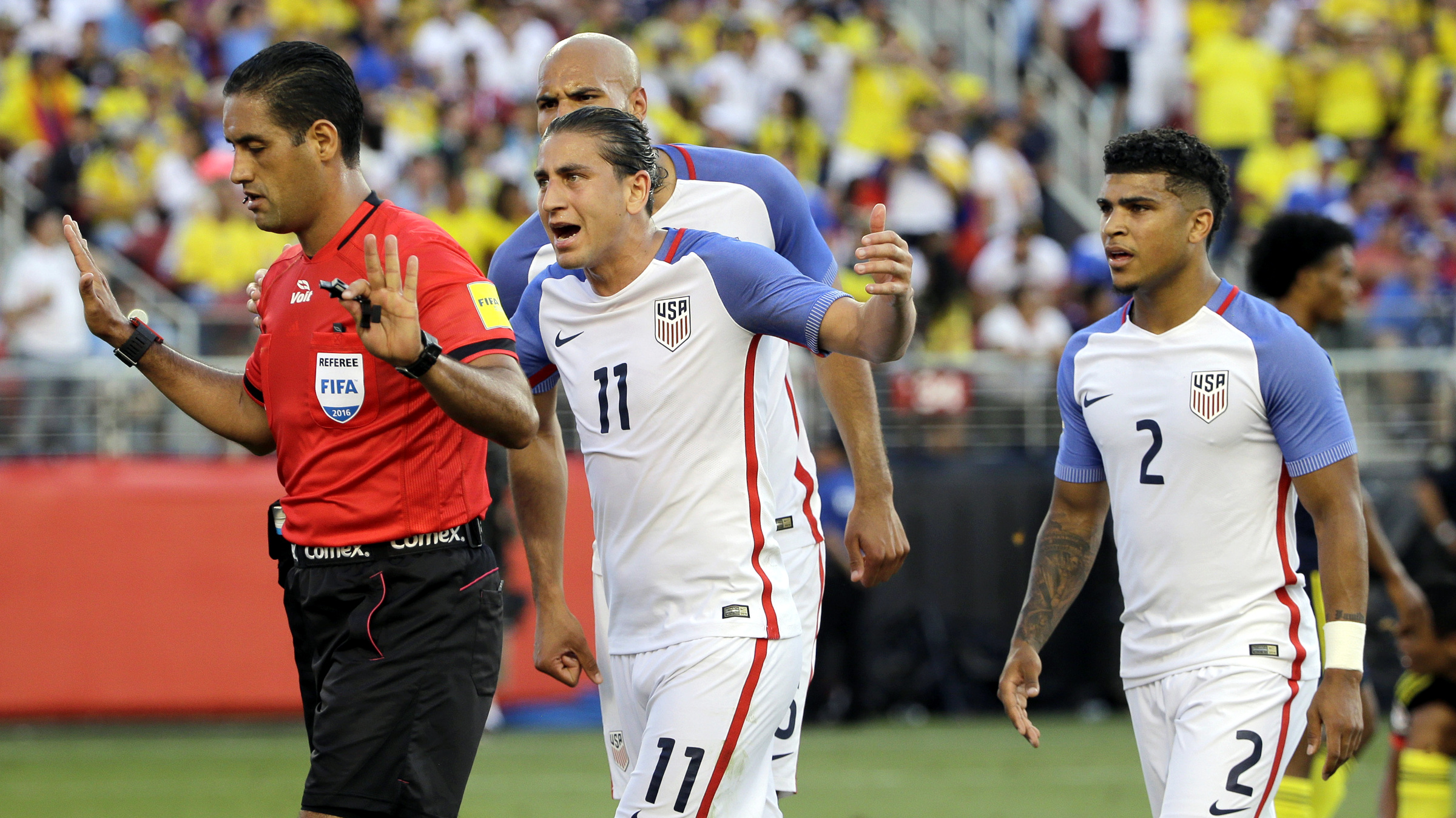 Alejandro Bedoya of the United States argues with referee Roberto García Orozco, after he awarded a penalty to Colombia during the opening match of the Copa America Centenario at Levi's Stadium in Santa Clara, Calif., Friday, June 3, 2016.