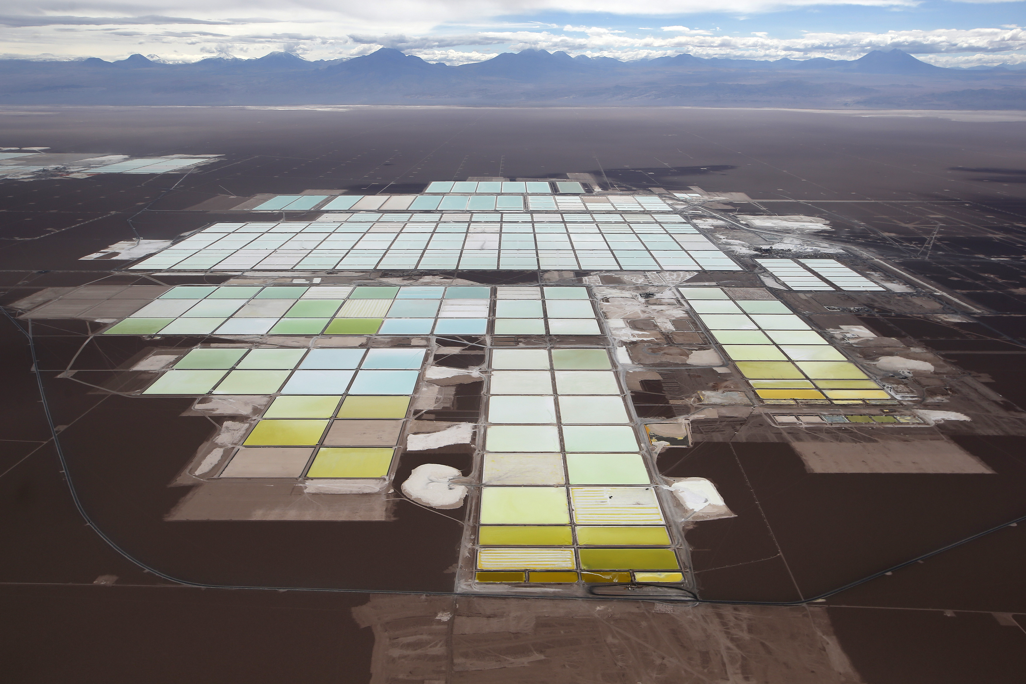 An aerial view shows the brine pools and processing areas of the SQM lithium mine on the Atacama salt flat, in the Atacama desert of northern Chile