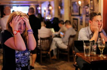 People gathered in The Churchill Tavern, a British themed bar, react as the BBC predicts Briatin will leave the European Union, in the Manhattan borough of New York, U.S., June 23, 2016.