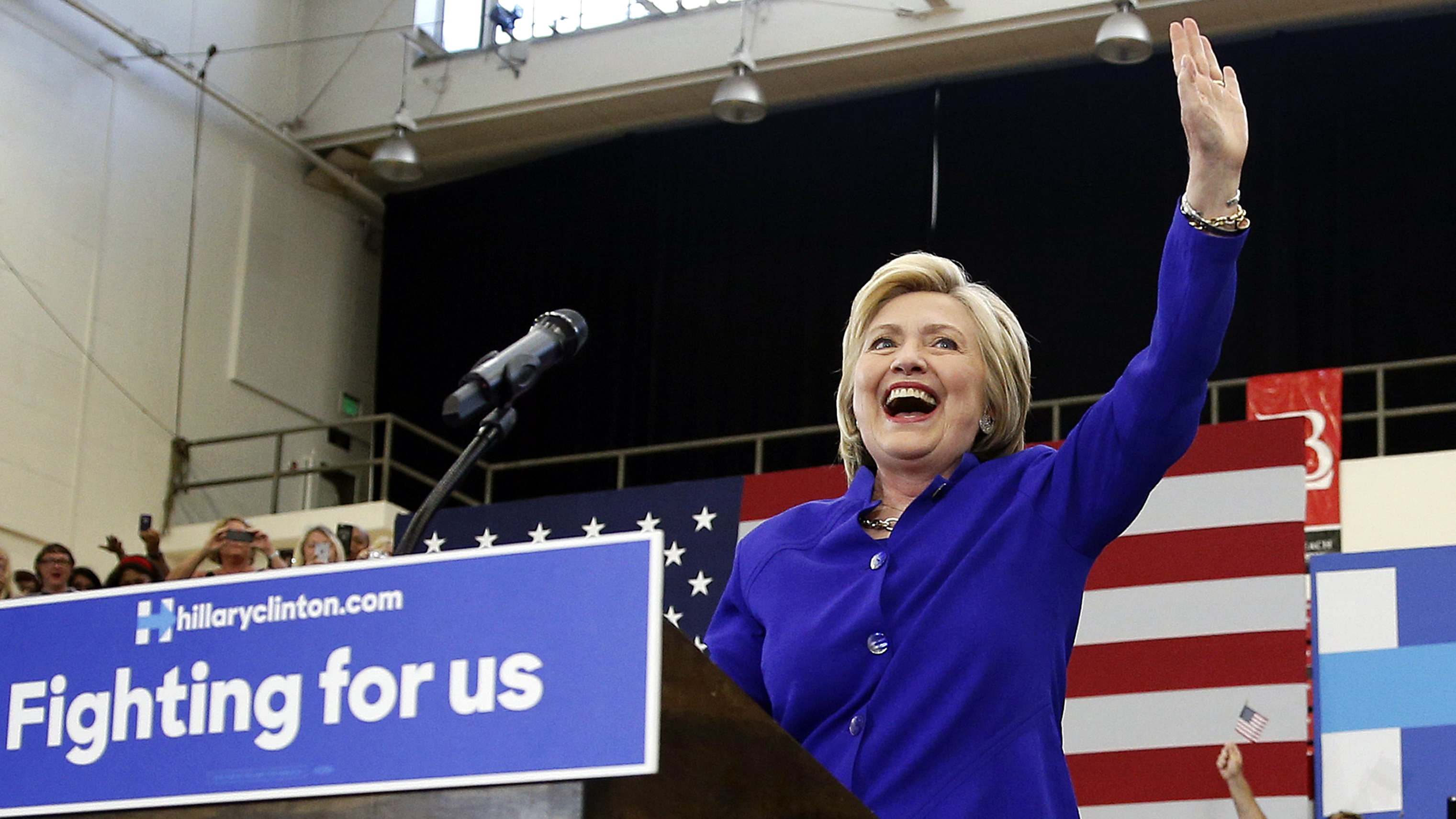 Democratic presidential candidate Hillary Clinton, left, reacts as she takes the stage with Robert Garcia, mayor of the City of Long Beach, at a rally, Monday, June 6, 2016, in Long Beach.