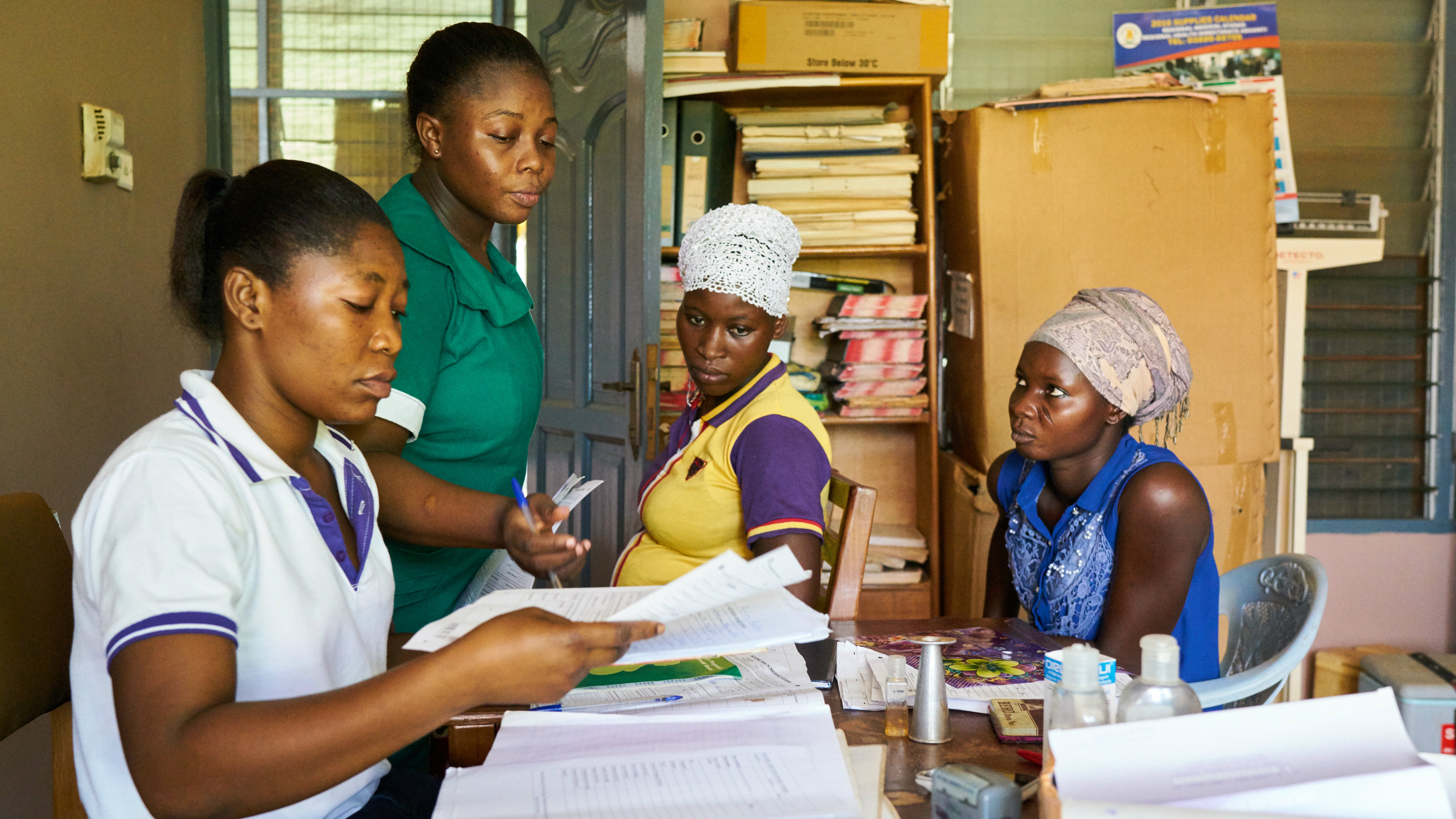 A community health worker attending to a patient in a health center in Datano Community, Amansie West district, Ashanti region
