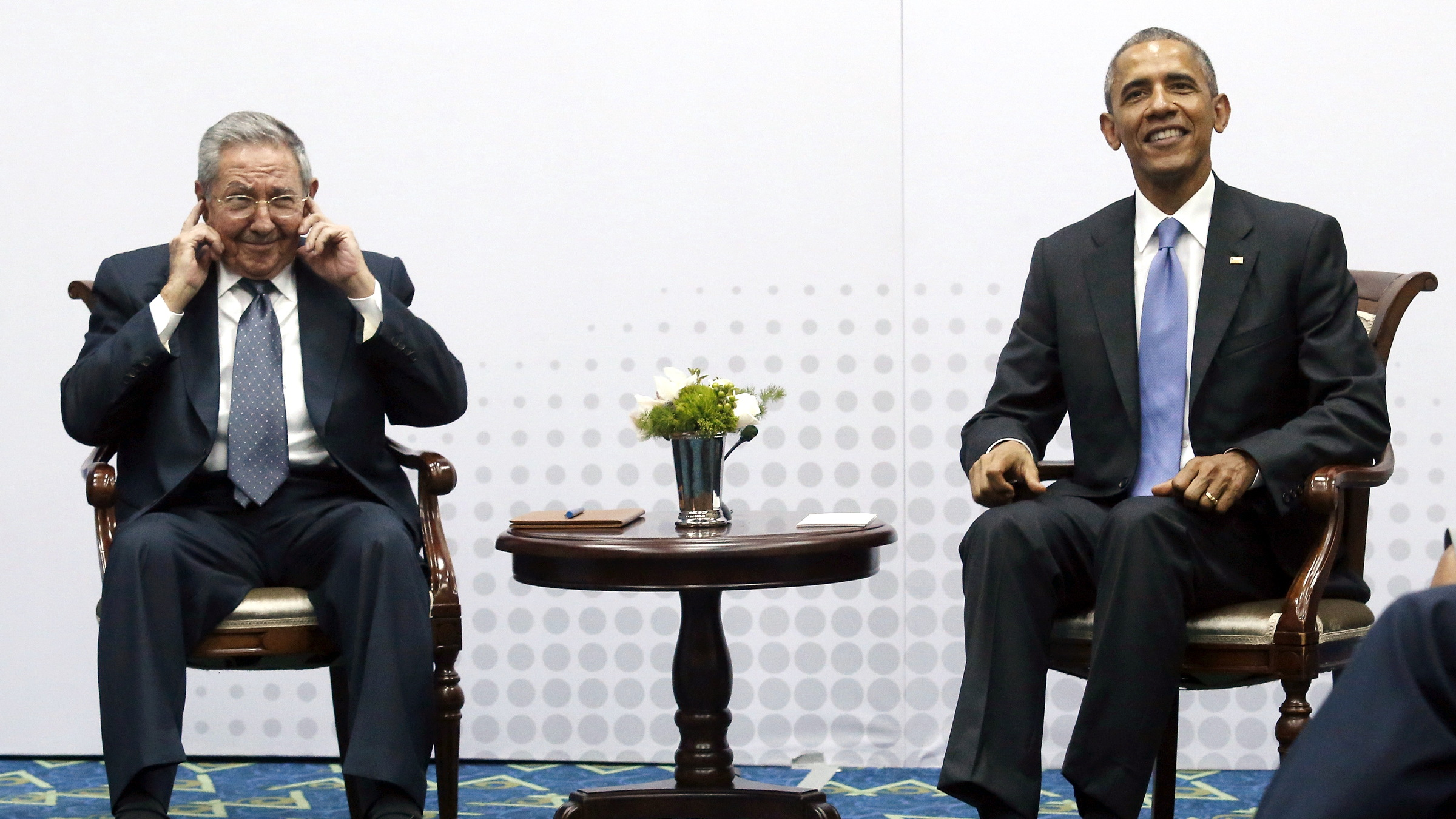 Cuba's President Raul Castro pretends not to hear questions from journalists as he and U.S. President Barack Obama hold a bilateral meeting during the Summit of the Americas in Panama City, Panama April 11, 2015. Neither president took questions from the press. Obama and Castro shook hands on Friday at the summit, a symbolically charged gesture as the pair seek to restore ties between the Cold War foes.