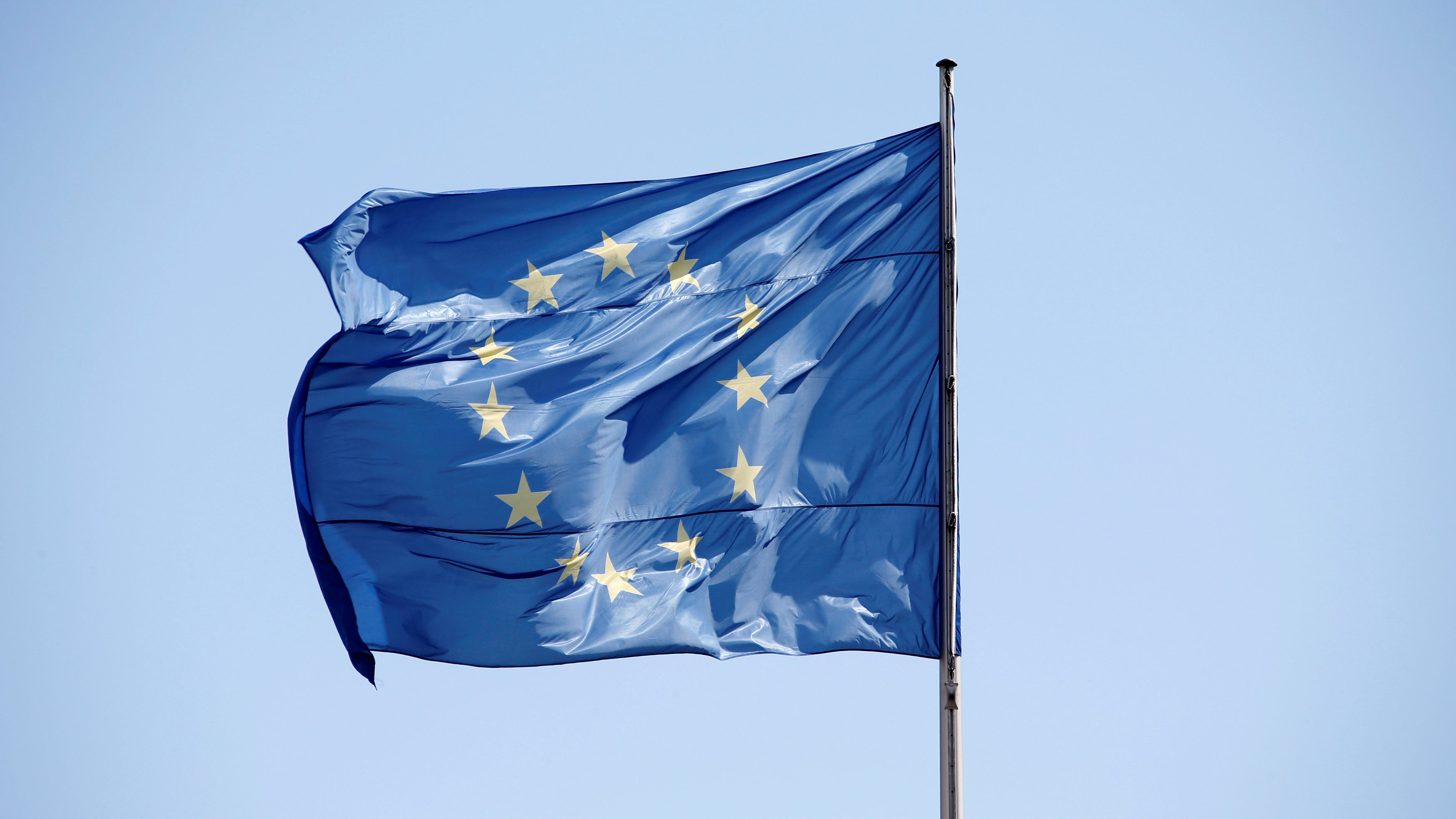 The European Union (EU) flag is seen on a sunny day and blue sky at the Chancellery in Berlin, Germany